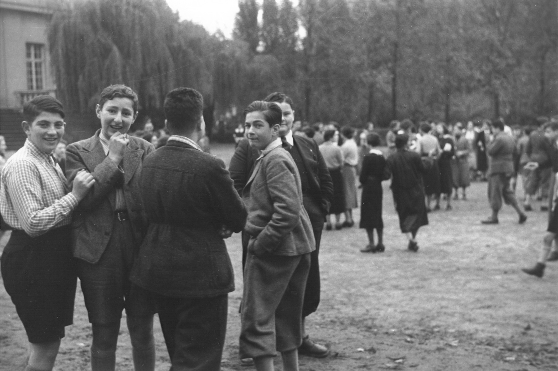 A group of teenage boys stands outside on the grounds of the Goldschmidt Jewish private school in Berlin-Grunewald.