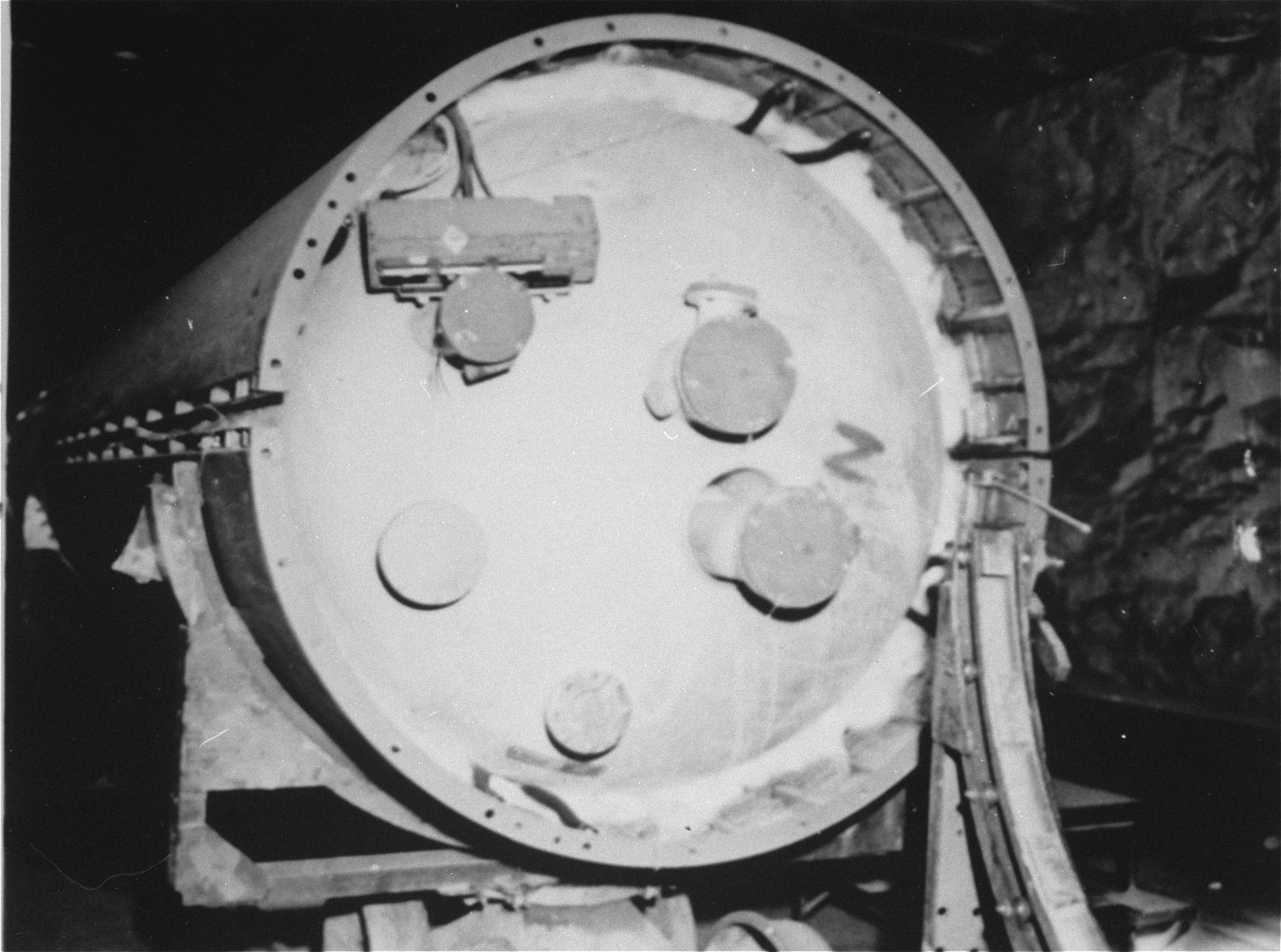The center section, showing the oxygen tank, of a V-2 rocket in the underground rocket factory at Dora-Mittelbau.