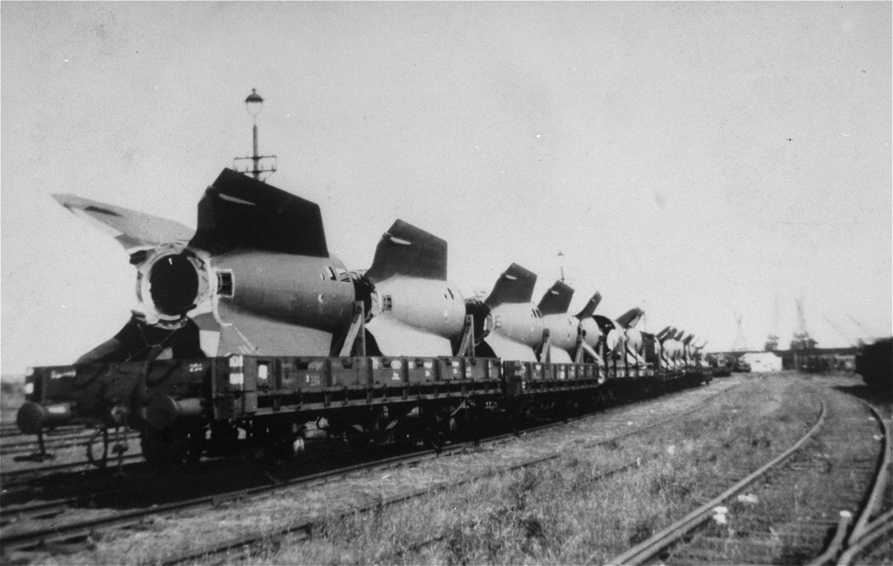 V-2 rocket tail fins manufactured at Dora-Mittelbau, are sent by rail to Antwerp, where they will be trans-shipped to the United States.