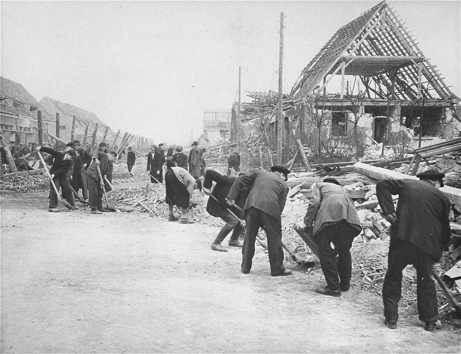 German civilians clear rubble at the Nordhausen concentration camp.