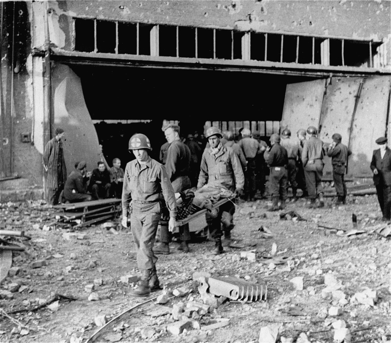 American medical personnel evacuate survivors for medical treatment at the Nordhausen concentration camp.
