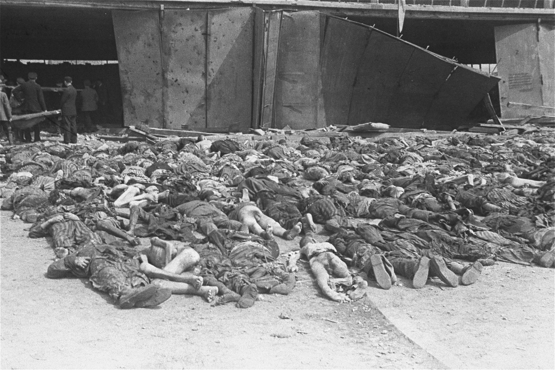 Rows of corpses lie outside the central barracks (Boelke Kaserne) in the Nordhausen concentration camp.