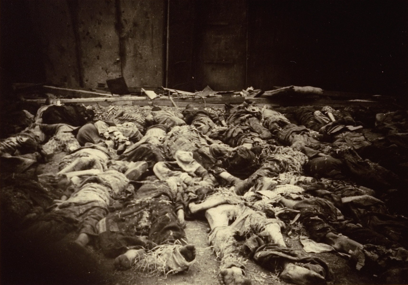 The bodies of prisoners lie on the ground in the newly liberated Nordhausen concentration camp.
