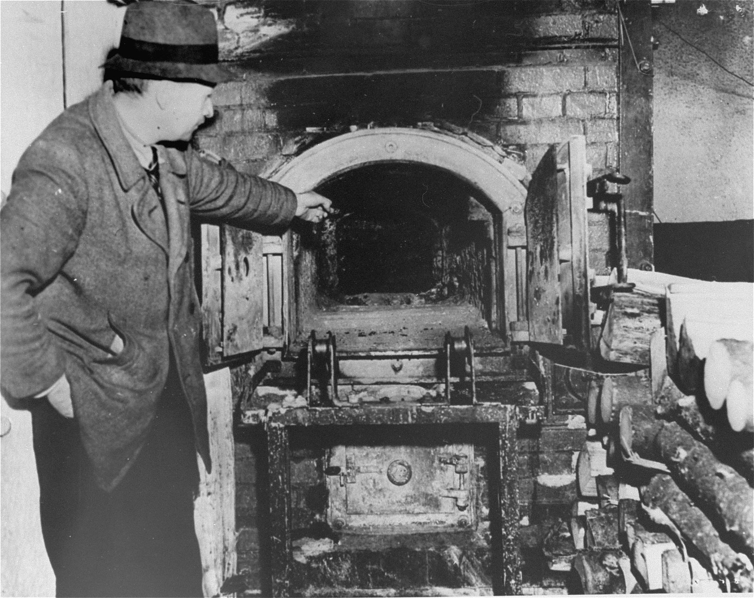A French survivor shows the crematorium in Flossenbuerg to a photographer.
