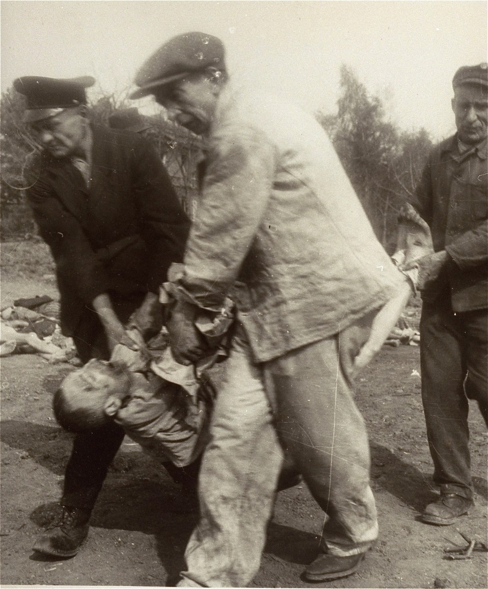 German civilians carry the body of a prisoner from the Nordhausen concentration camp to a mass grave for burial.