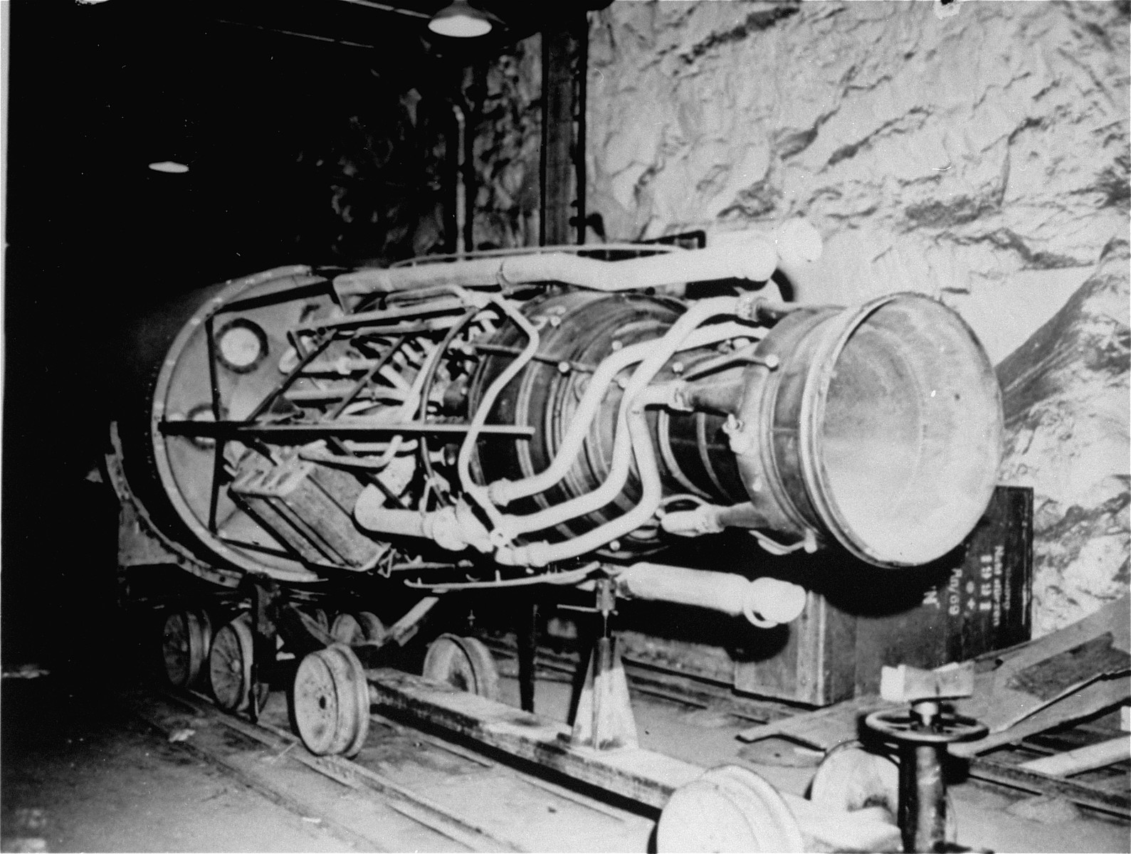 The propulsion unit of a V-2 rocket in the underground factory at Dora-Mittelbau.