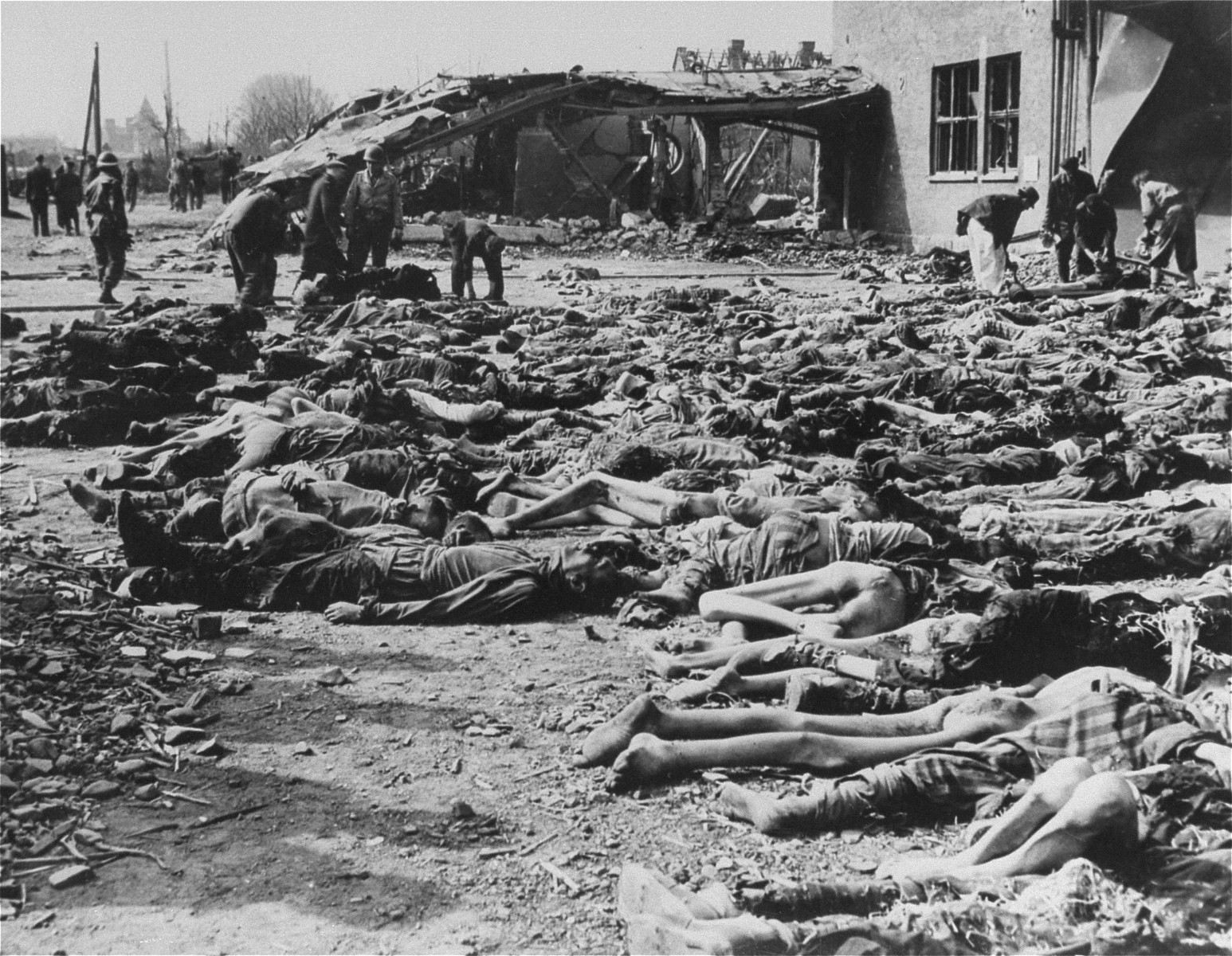 American troops supervise the burial of hundreds of corpses by German civilians from the nearby town of Nordhausen.