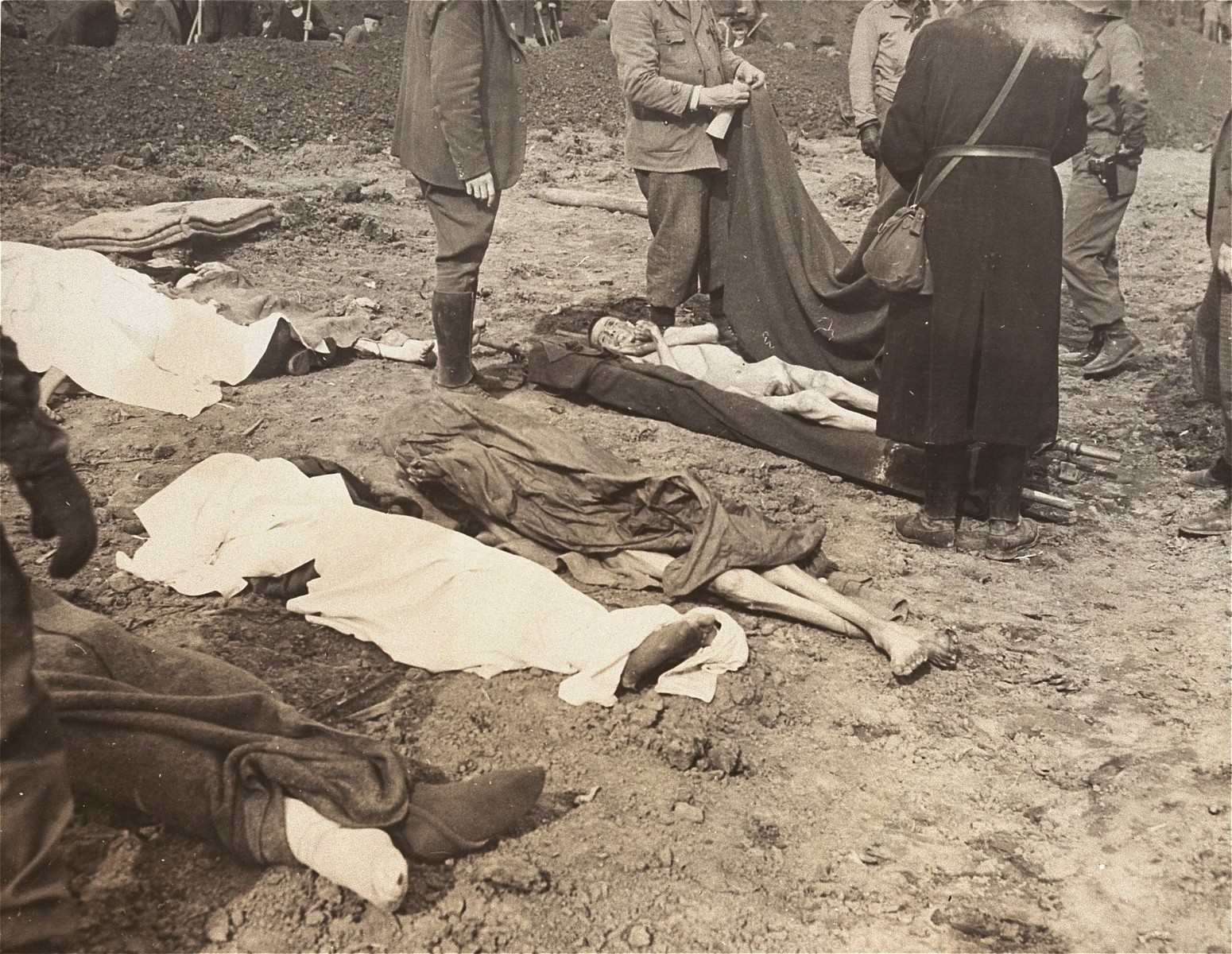 German civilians from the nearby town of Nordhausen prepare the bodies of prisoners found at the Nordhausen concentration camp for burial.