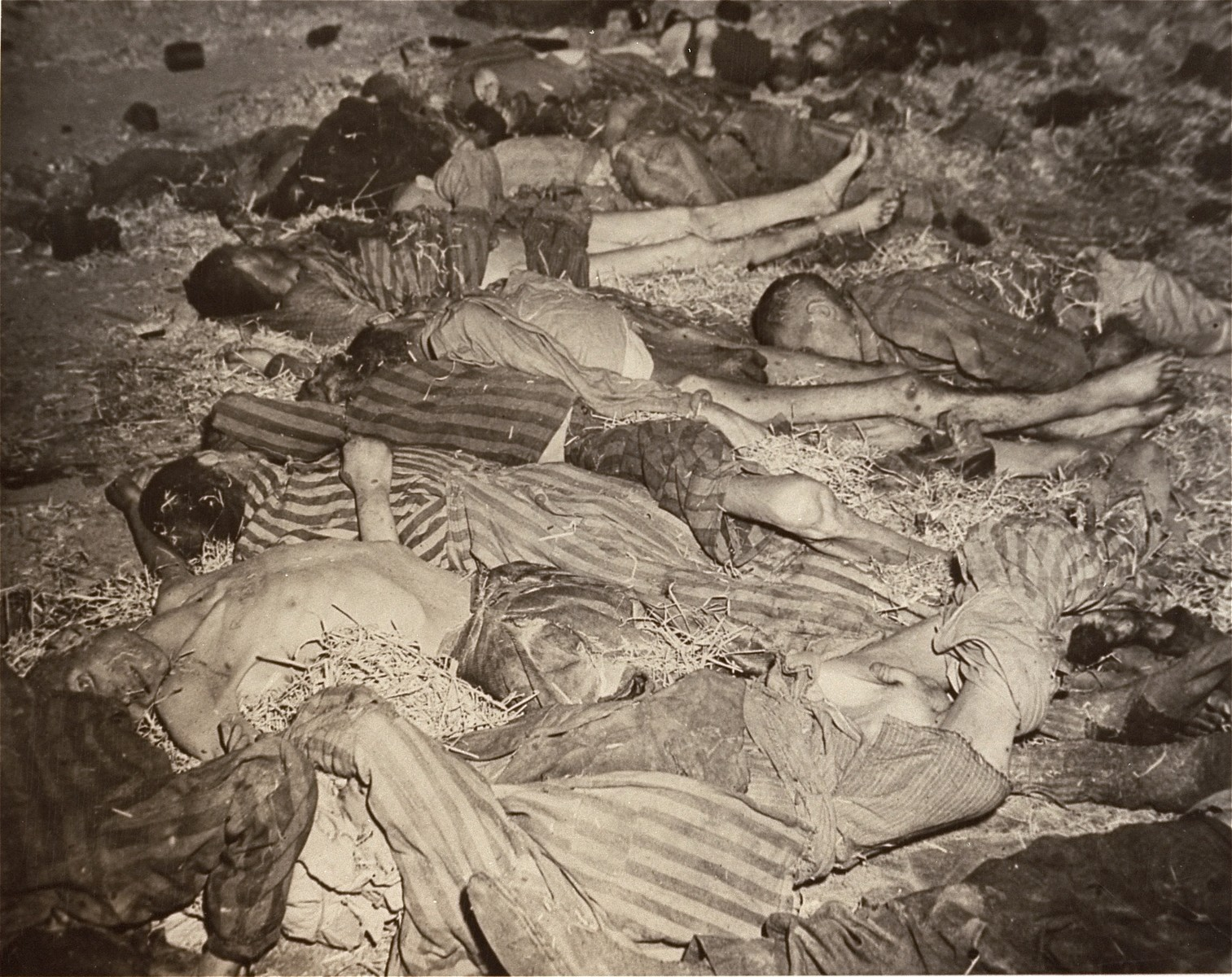 The bodies of prisoners lie on the ground inside barracks in the Nordhausen concentration camp.