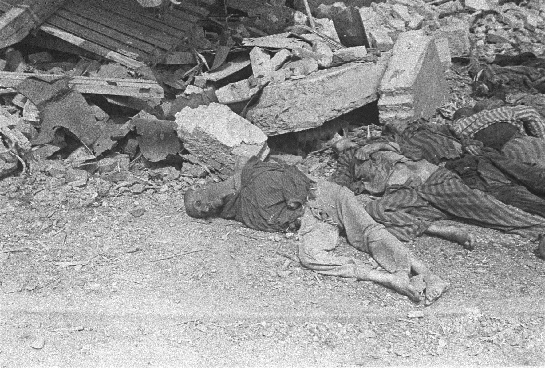 Corpses lie on the ground in the newly liberated Nordhausen concentration camp.