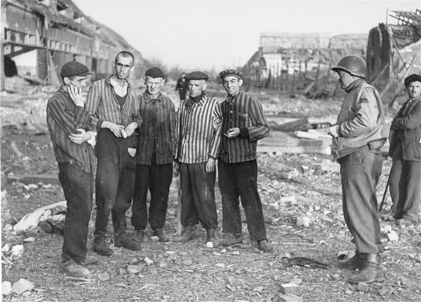 An American soldier speaks outside with five survivors in the Nordhausen concentration camp.