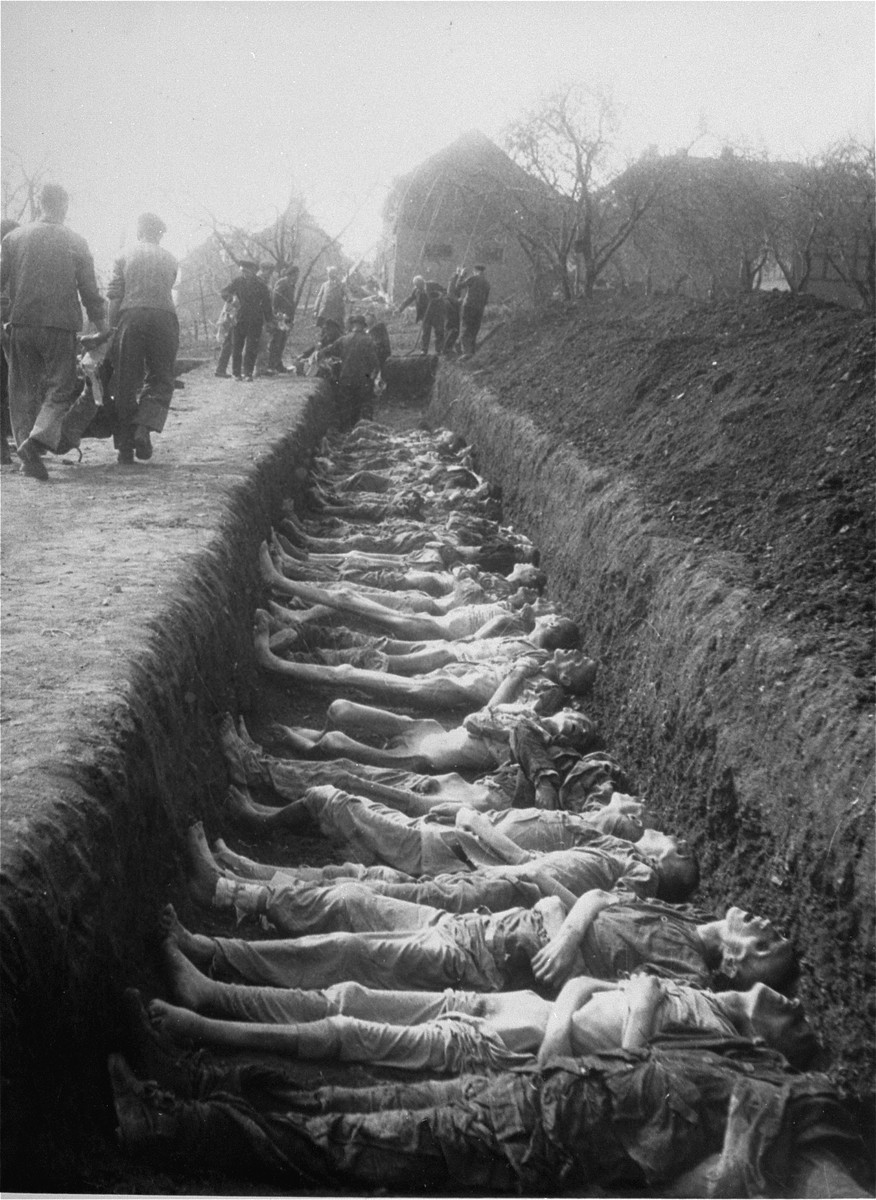 German civilians from the town of Nordhausen bury the bodies of former prisoners found in the Nordhausen concentration camp in a mass grave.