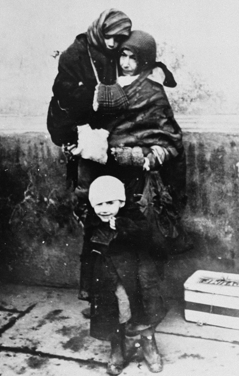 A Jewish woman and her two young children await deportation from the Krakow ghetto.