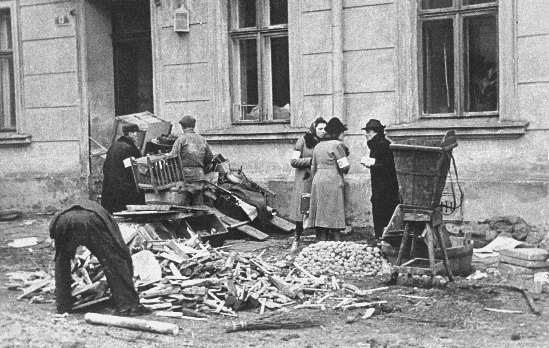 A group of Jews chop up furniture to use as fuel in the Krakow ghetto.