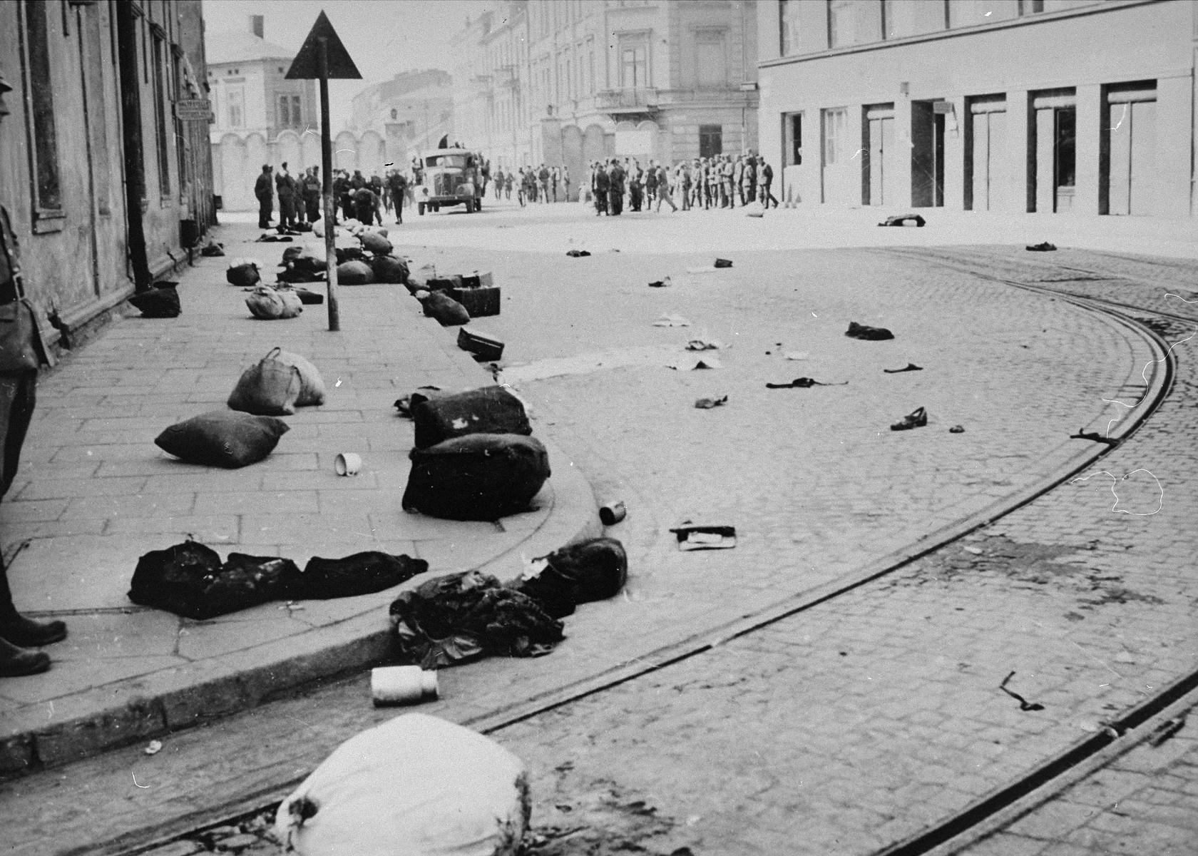 View of a major street in Krakow after the liquidation of the ghetto, which is strewn with the bundles of deported Jews.