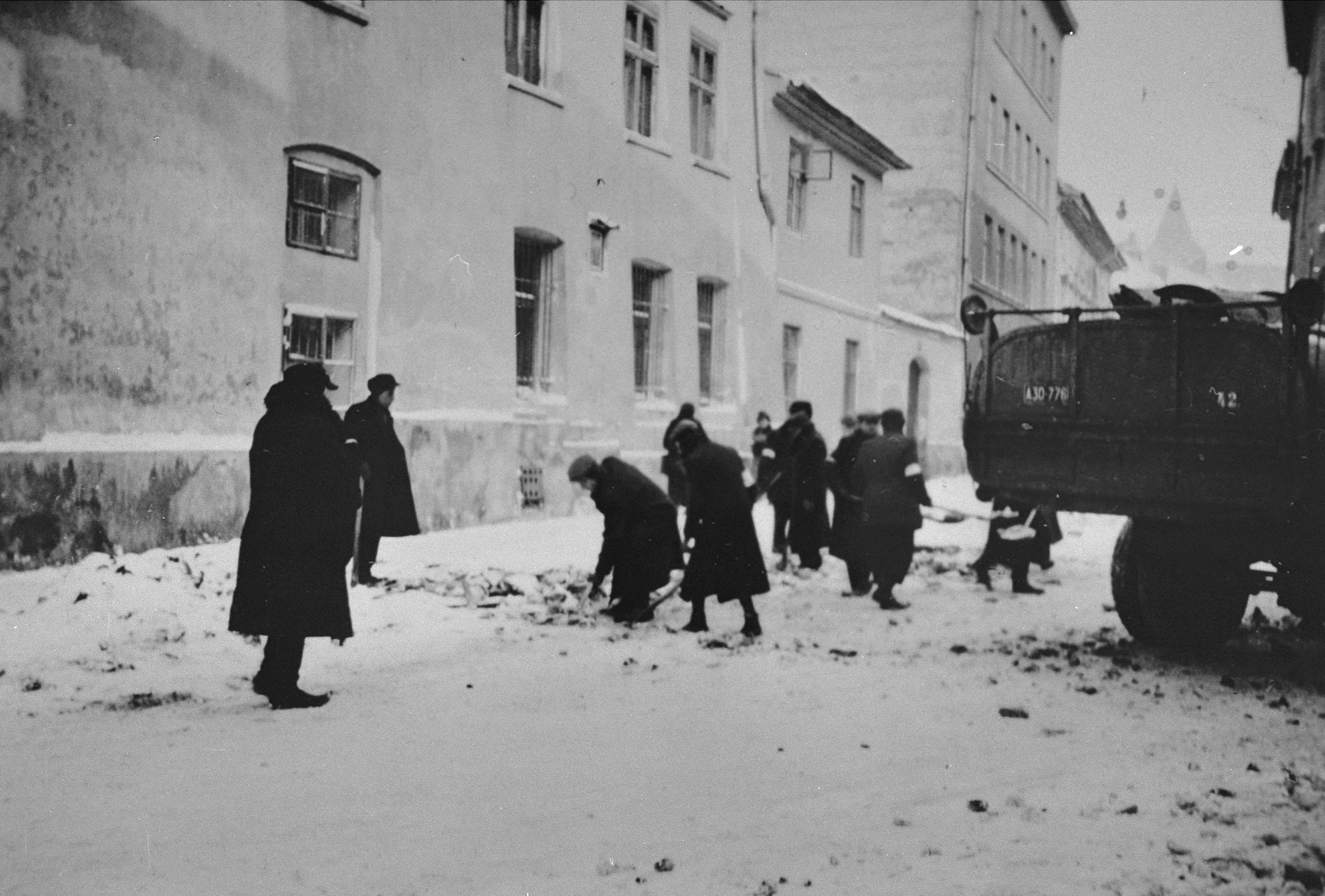 Jews are forced to clear snow from streets of Krakow.