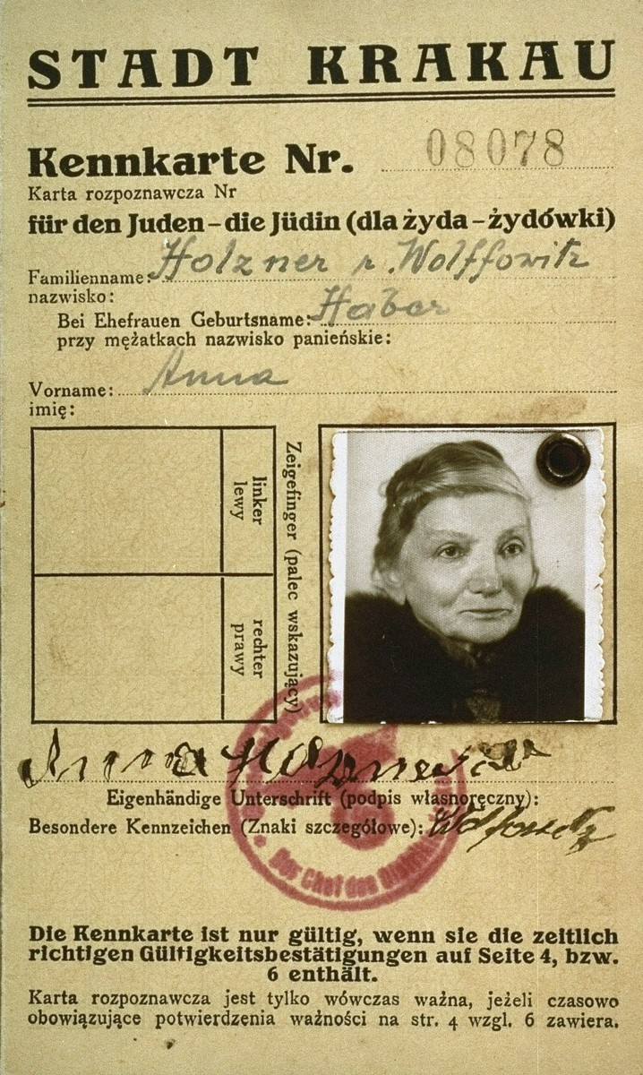 A photo identification card, bearing the official stamps of the Krakow labor office and the General Government, Krakow district, that was issued to the Polish Jew,  Anna Holtzner Haber Wolffowitz.