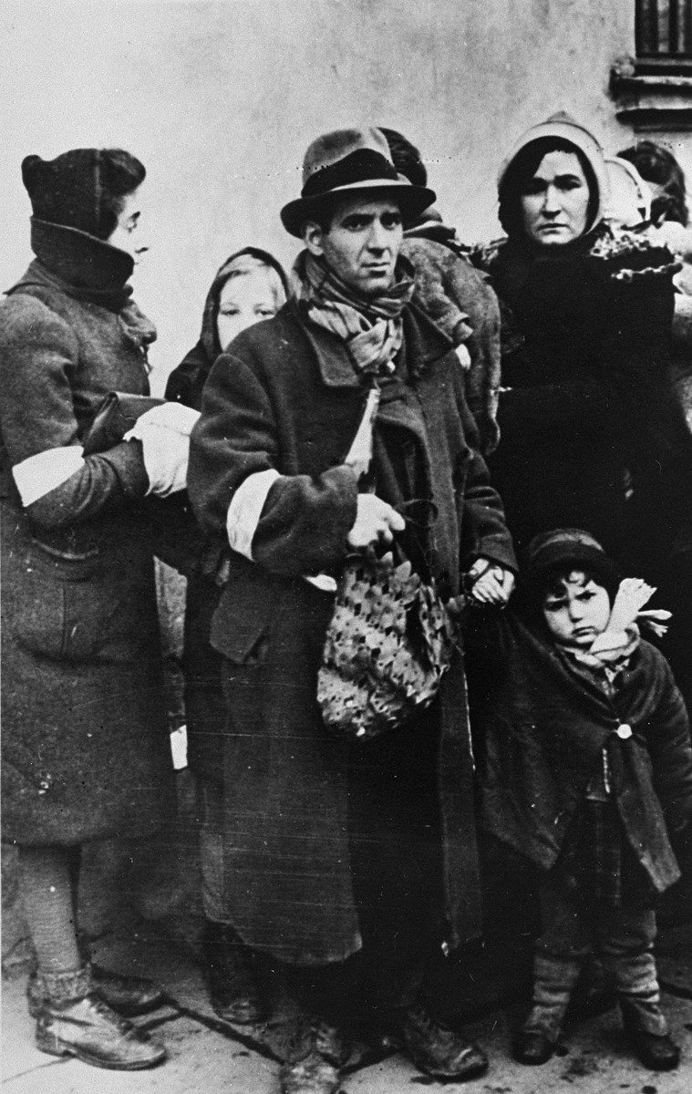 Jews gathered at an assembly point await deportation.