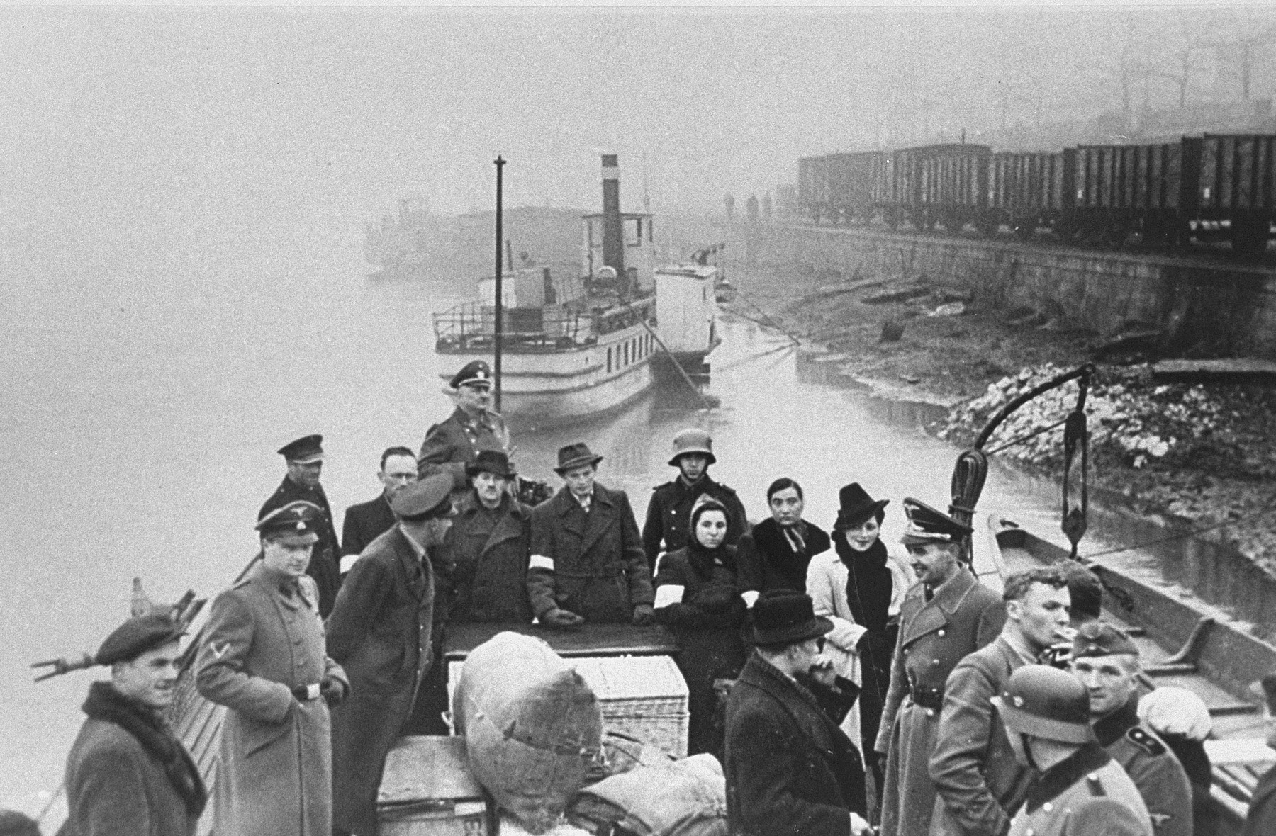 Jews are transported by ferry across the Vistula River for resettlement in the Krakow ghetto.