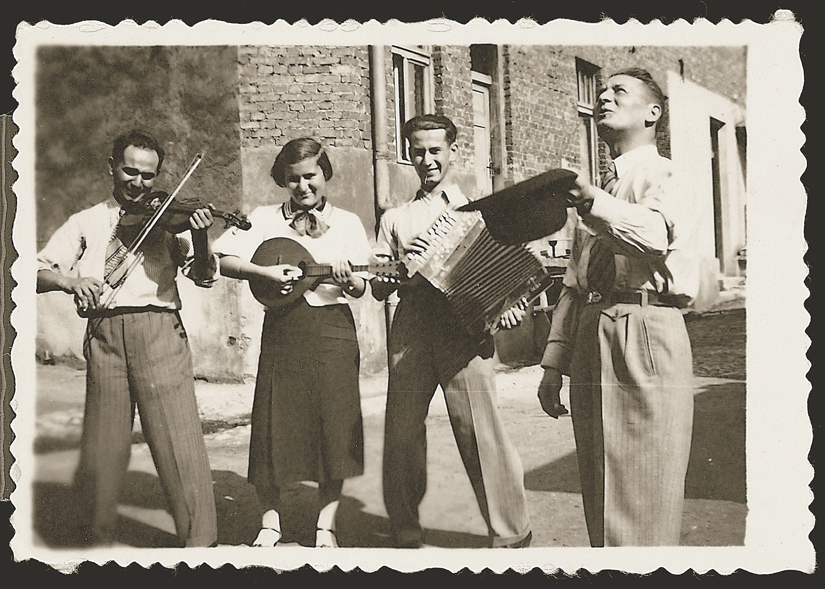 Chiel, Genia, Josef and Szlomo Gelbard perform an outdoor musical recital.
