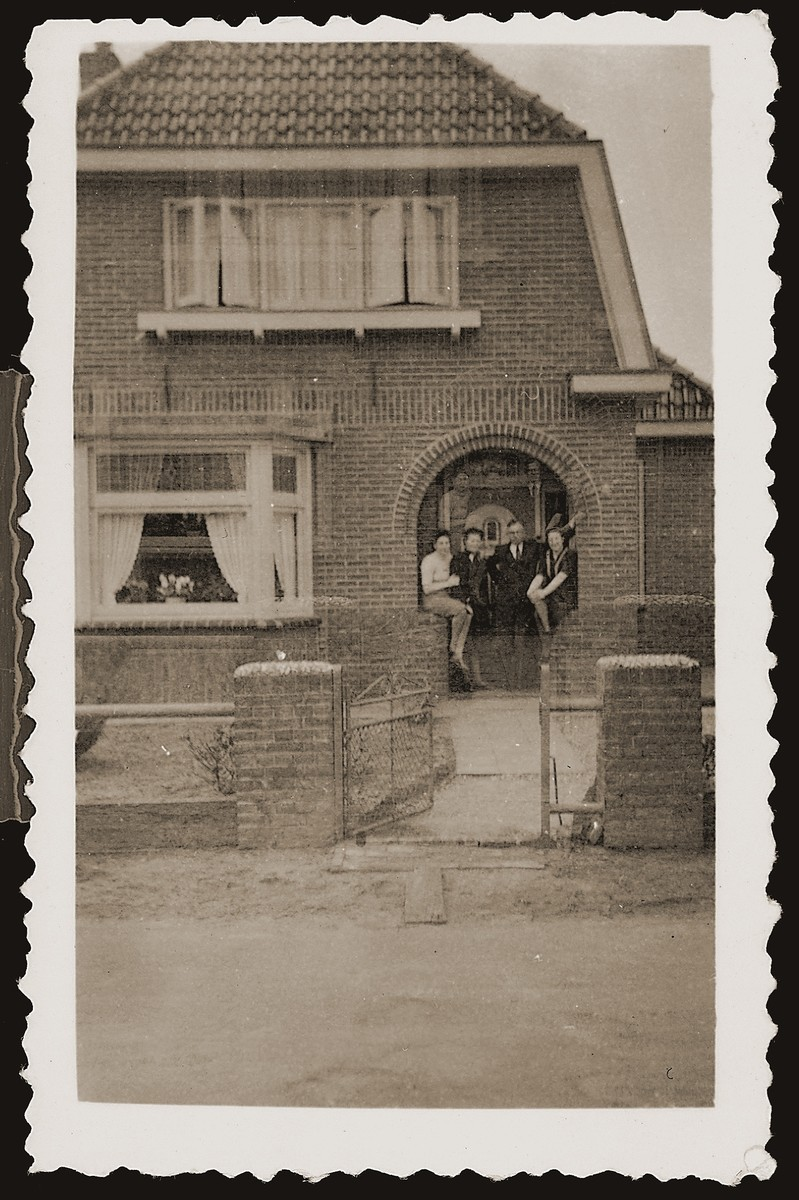Bep Meijer and Gerta Sajet visit with the Leuverink family on the porch of their home.  The Leuverinks were members of the Dutch Reformed Church who hid Jews during the war and served in the local resistance movement.