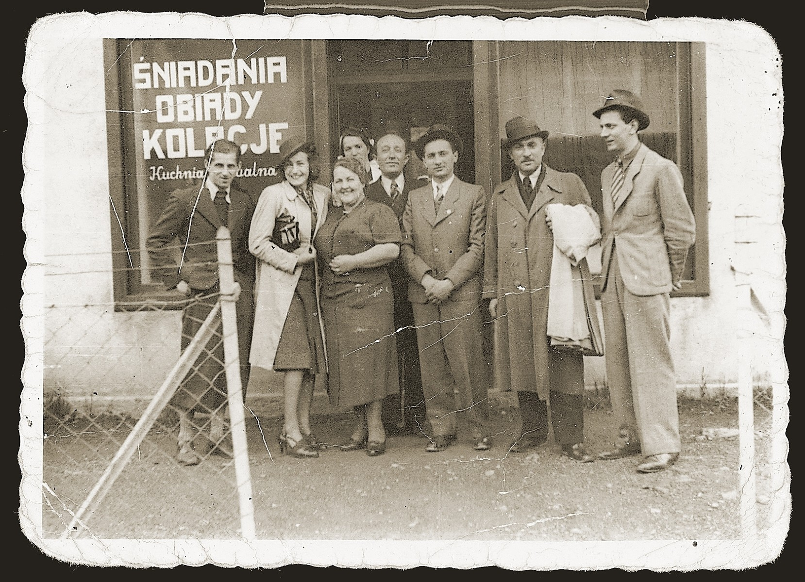 Members of the Swajcer family pose outside a cafe in Sosnowiec.
