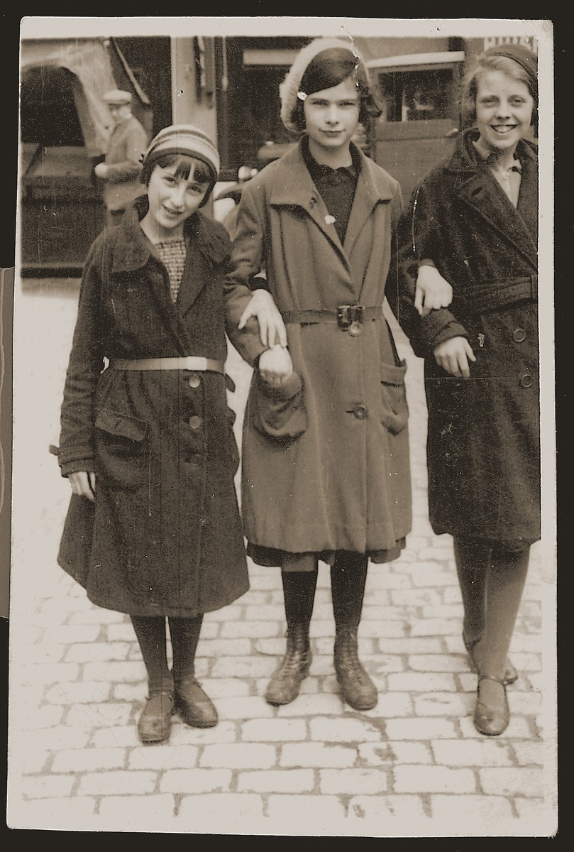 Three school friends on a street in Boekelo, Holland.  Pictured from left to right are: Bep Meijer, her cousin Beppie Meijer, and Lies Meilink, a Dutch classmate.  Beppie was killed in Auschwitz in February 1943.