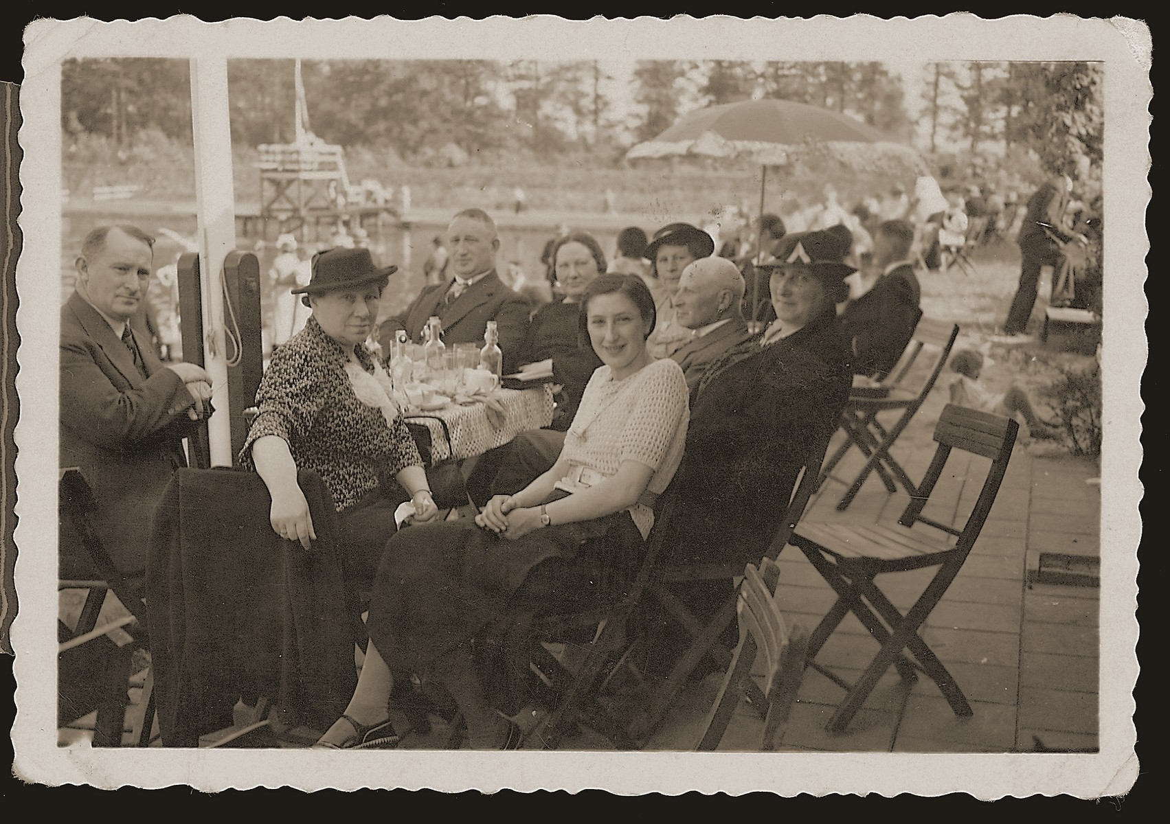 The Meijer family sits outside at a cafe during a Sunday outing.  Pictured counter-clockwise are Bep Meyer (front, right); Hennie Meijer Meijer; Joseph Meijer; Na Meijer Berg; Hedwig Meijer Neuman; Joseph Meijer (another); Johny Meijer; and Lina Meijer Neuman.