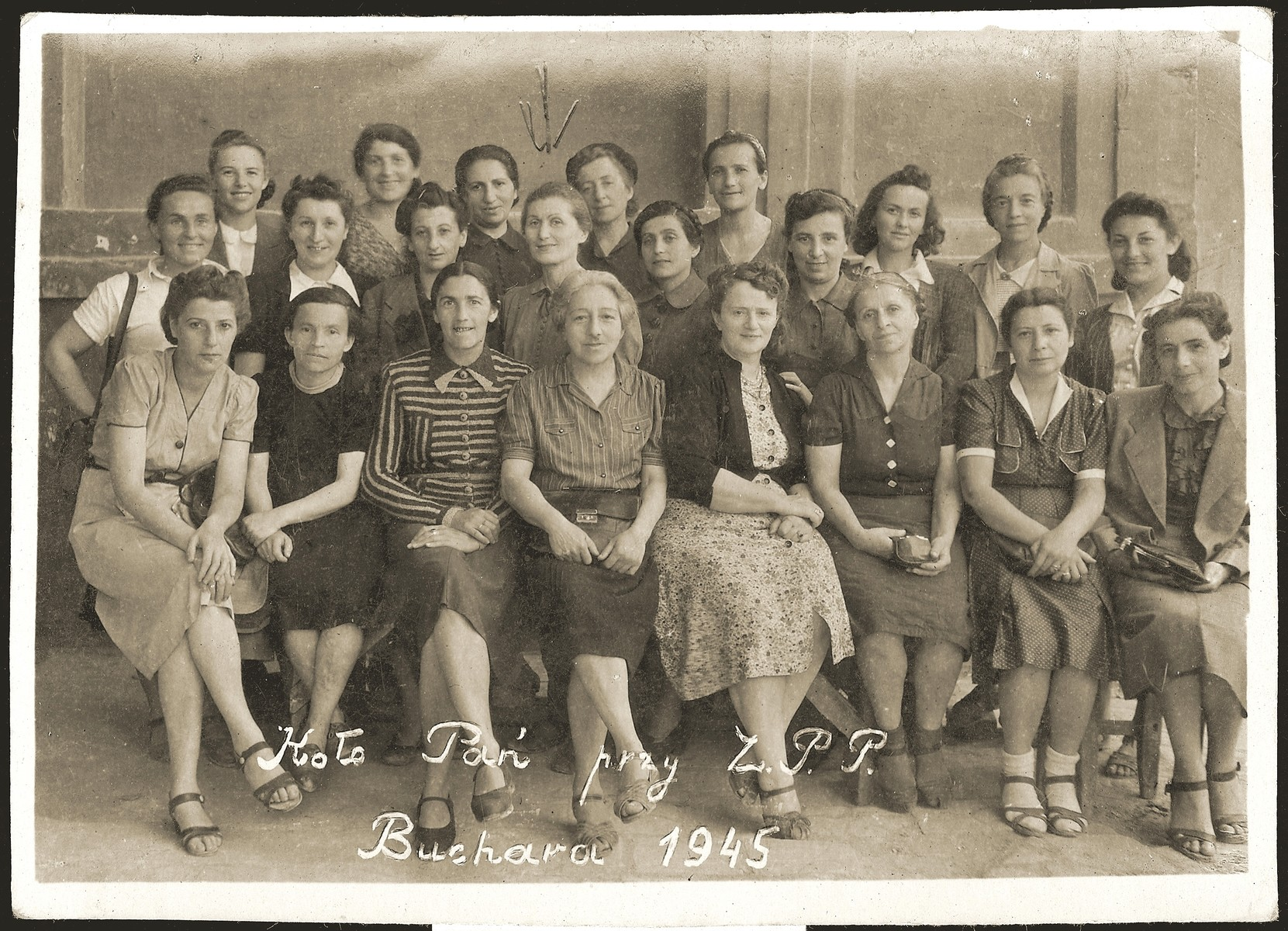 Group portrait of members of a Polish-Jewish women's group in Bukhara.    Lonia Liwer is pictured in the middle row, fourth from the left.