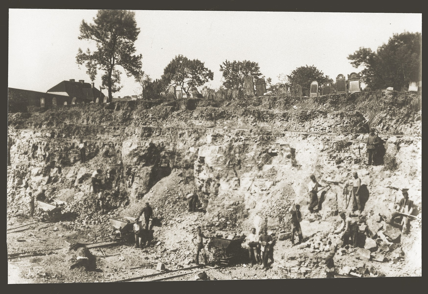 Jews at forced labor working on a hillside beneath the Jewish cemetery in Kamionka.
