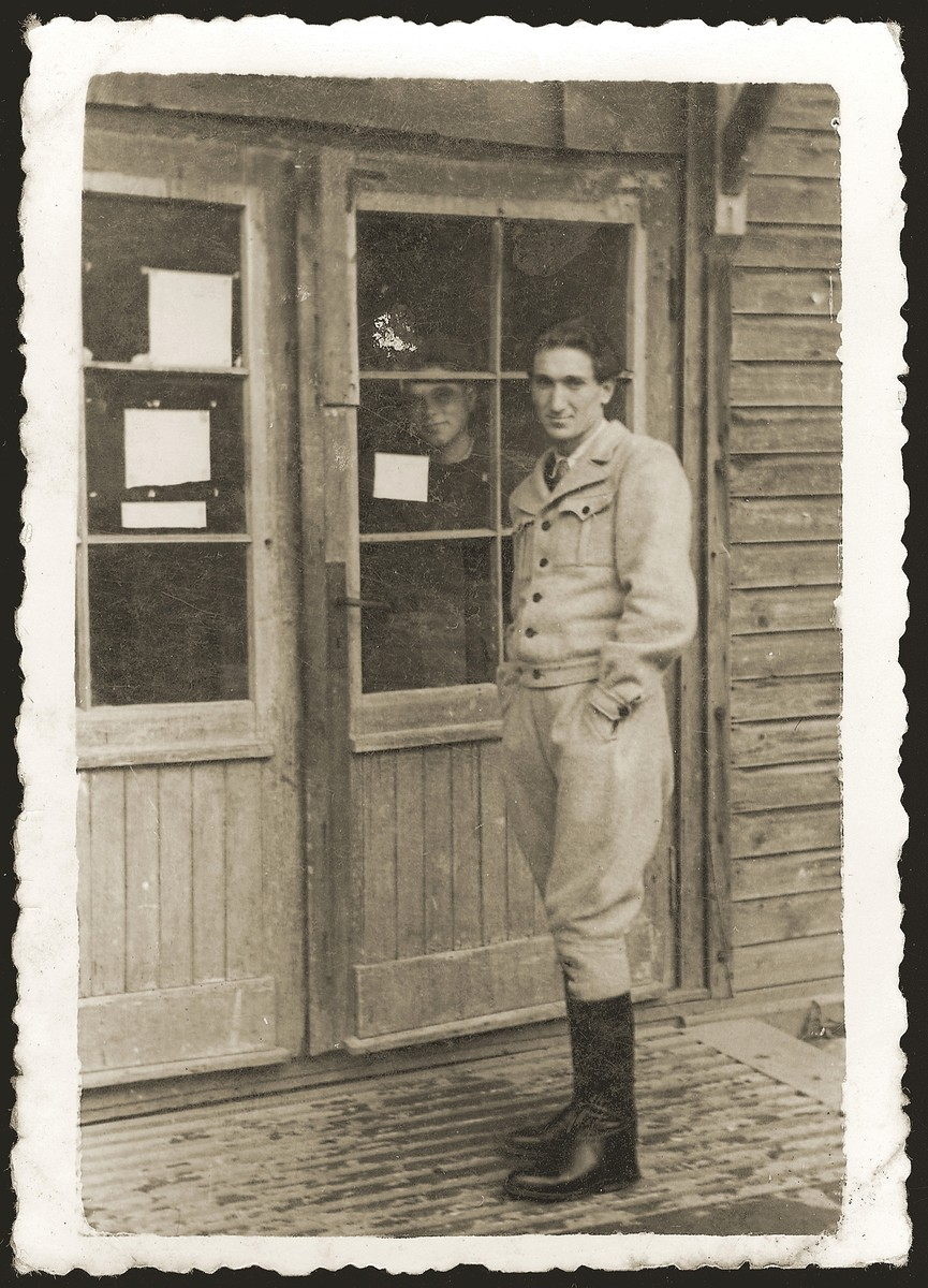 David Bromberg poses at the entrance to a barrack in the Ebensee displaced persons camp.  Bromberg is a Jewish DP who is a friend of Salek Liwer.