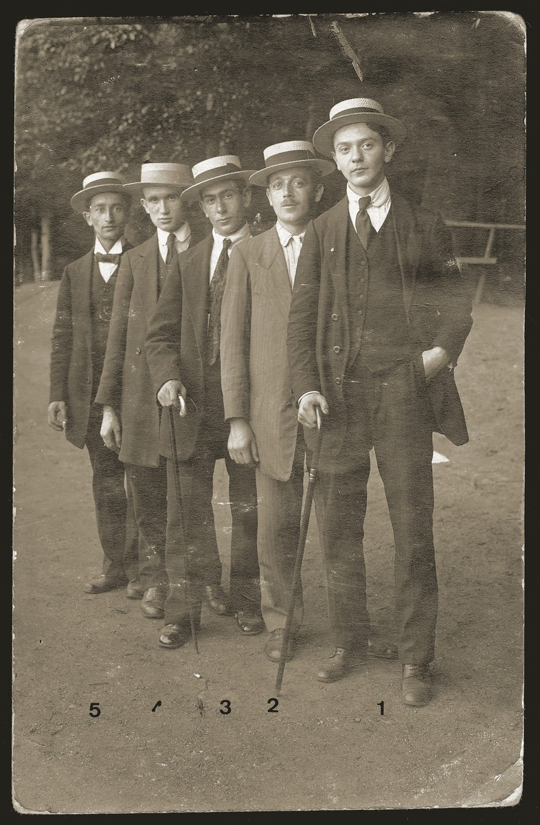 Szmuel Liwer (right) and four friends pose in fancy dress for a humorous photo to send back to their friends in Bedzin.  The young men are making a stop in Dusseldorf on their journey to Palestine, where they will join the ranks of the Third Aliyah (wave of immigration).