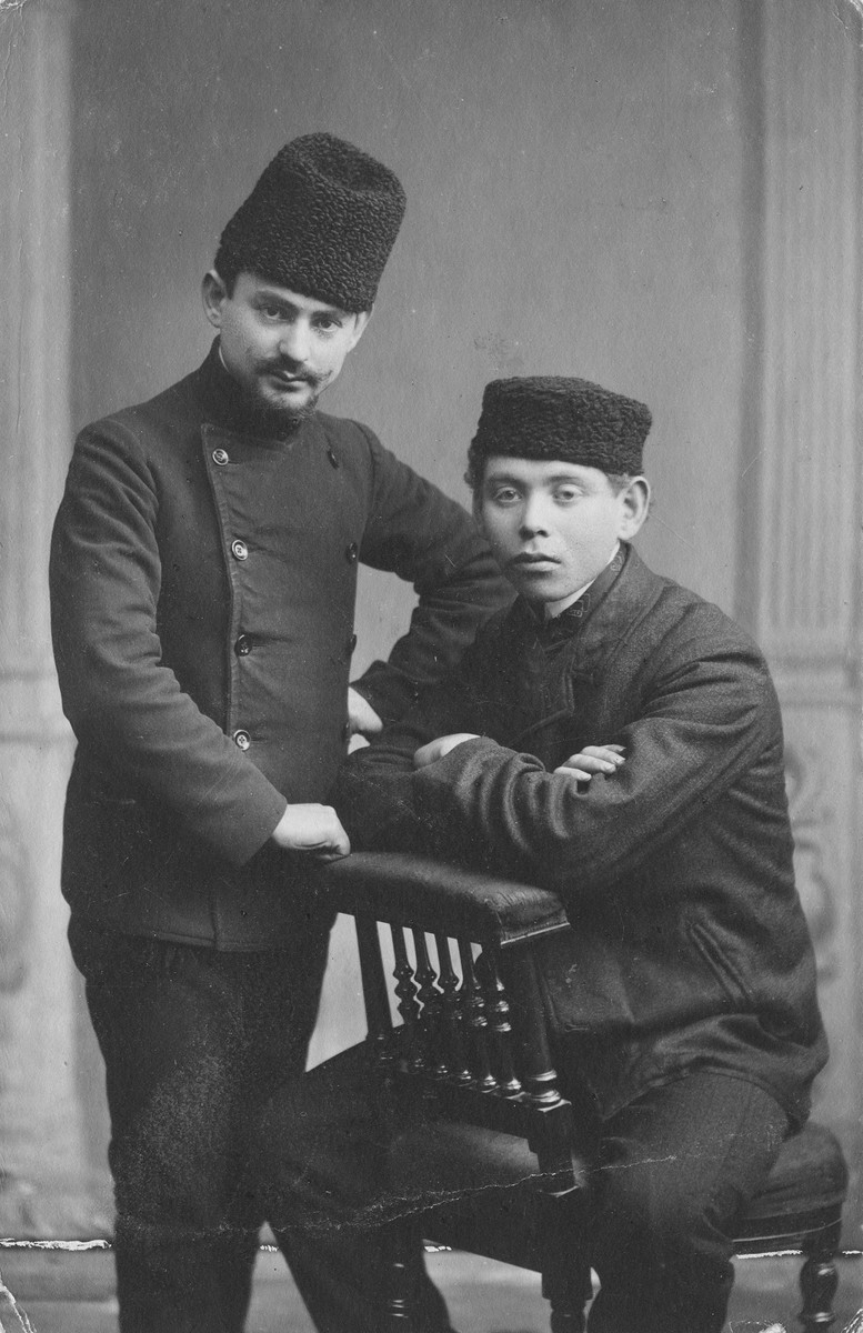 Studio portrait of two young Jewish men taken in Kaunas in the early 1900s.  Benzion Bloch is at the left.