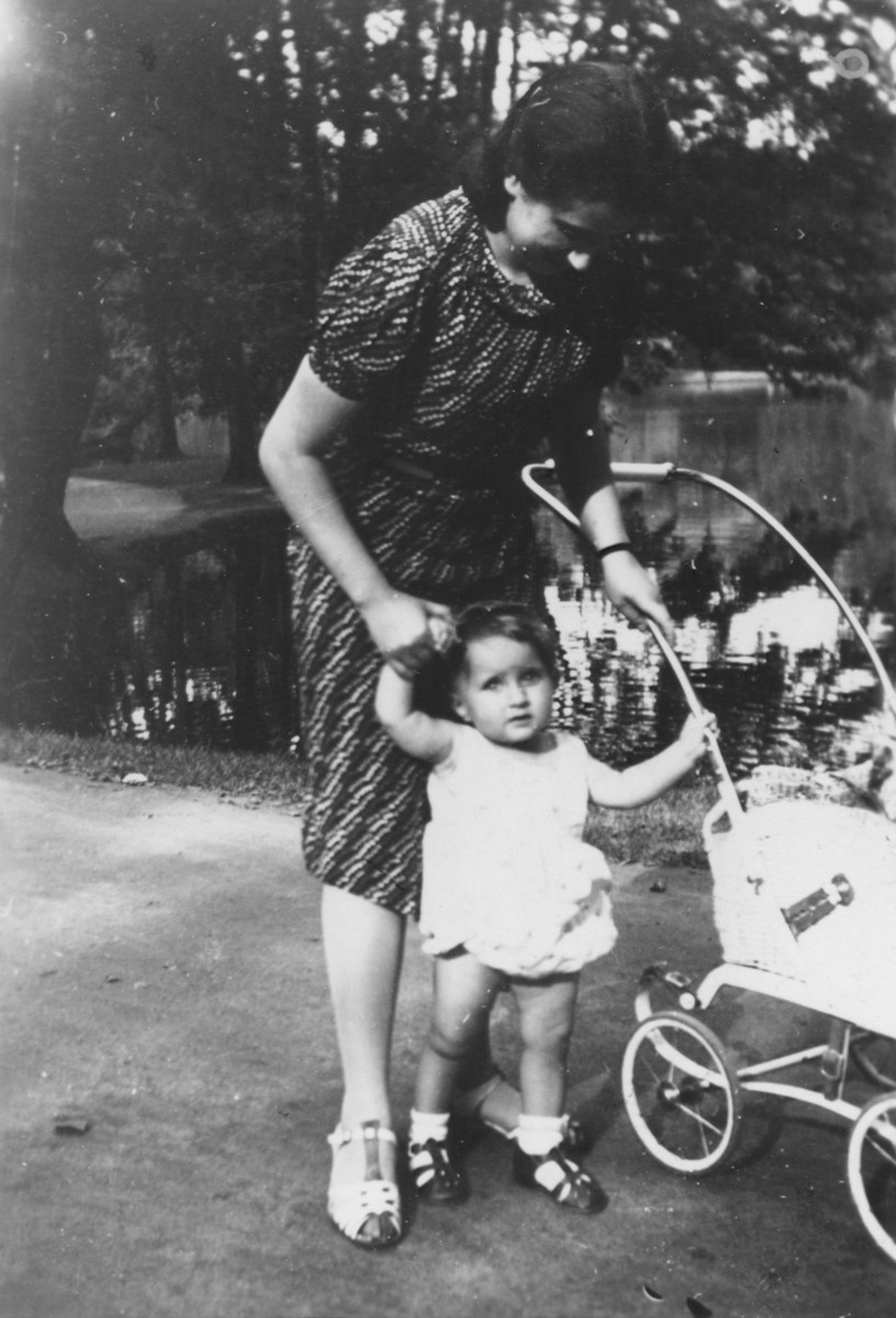 One-year-old Evelyn (Evy) Goldstein is taken for a walk in a Berlin park by her Aunt Ruth Thal.