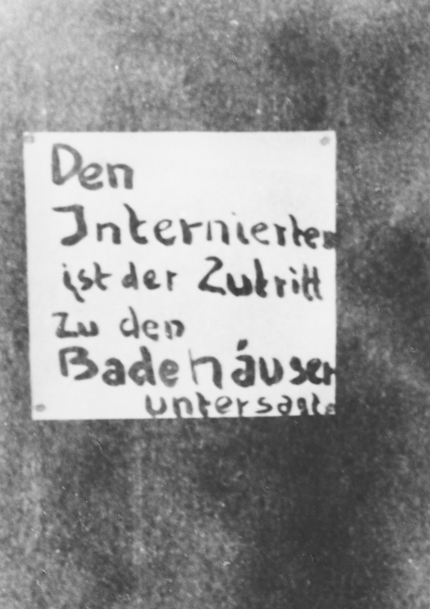 View of a sign posted on Lenzerheide Lake in front of the bathhouse forbidding entrance to refugees.    Lenzerheide was the site of an internment home for primarily Jewish refugees.