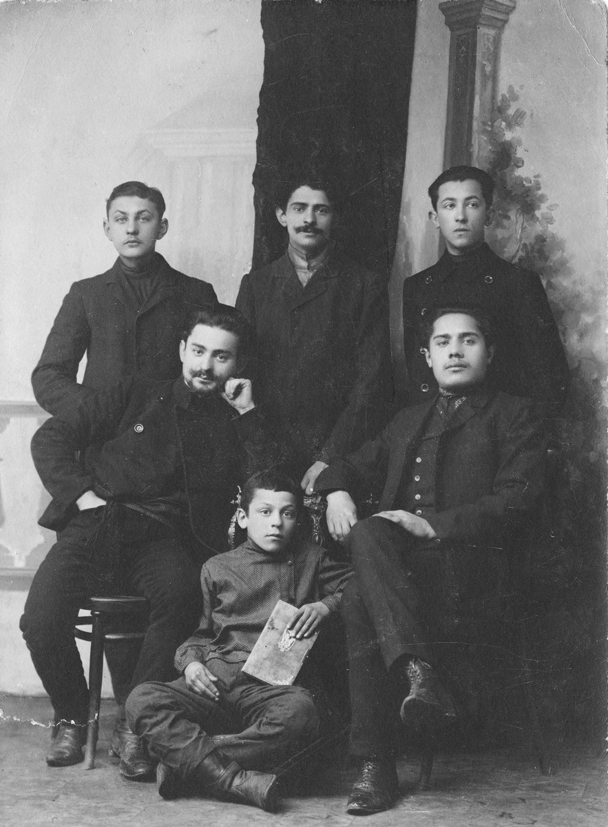Studio portrait of a group young Jewish men taken in the early 1900s.  Benzion Bloch is at the left.