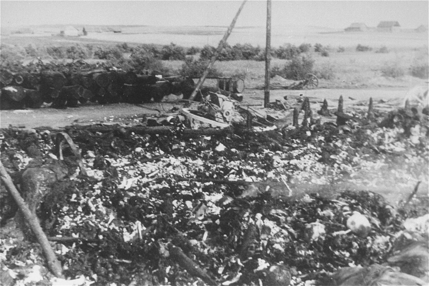 View of the charred remains of Jewish victims burned in a barn by the Germans near the Maly Trostinets concentration camp.