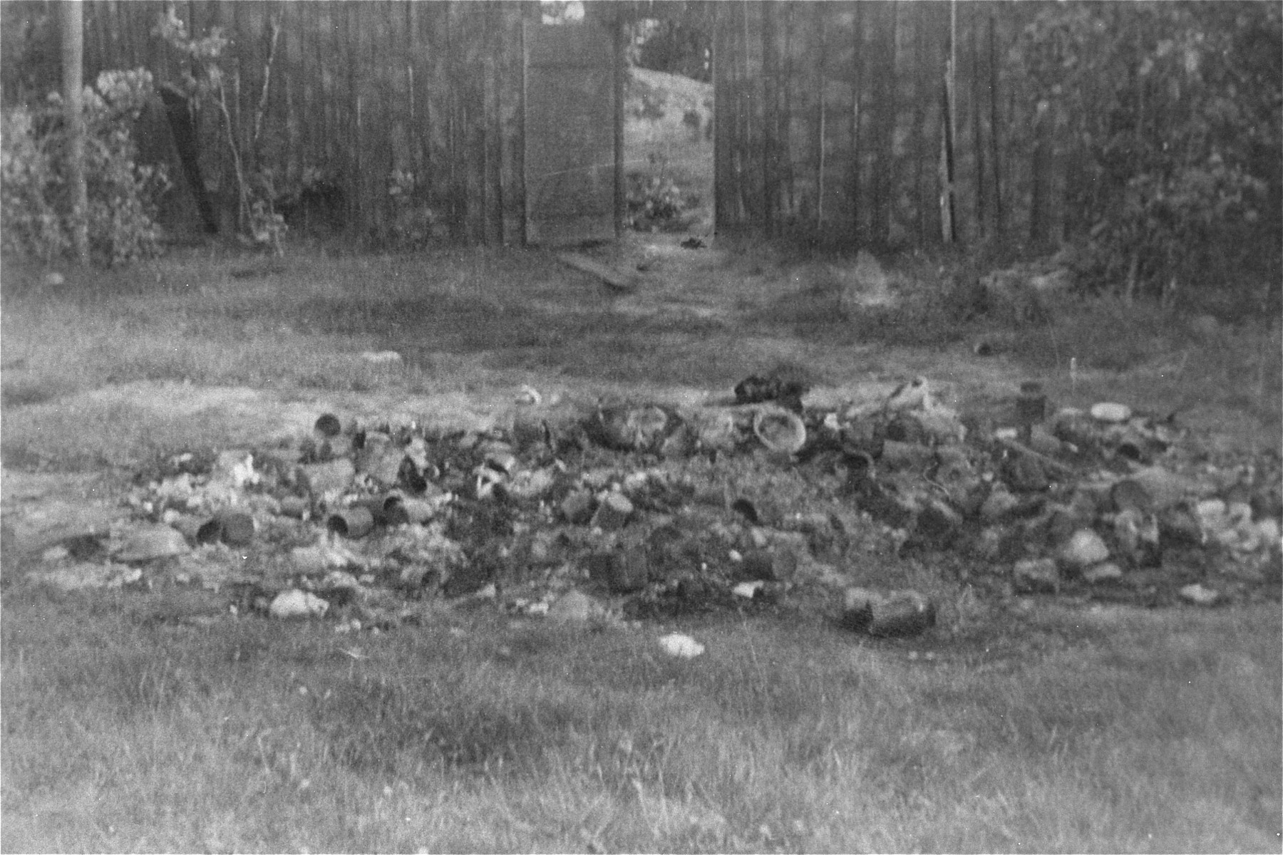 The personal effects of prisoners killed by the Germans lie in a pile on the grass in the Maly Trostinets concentration camp.