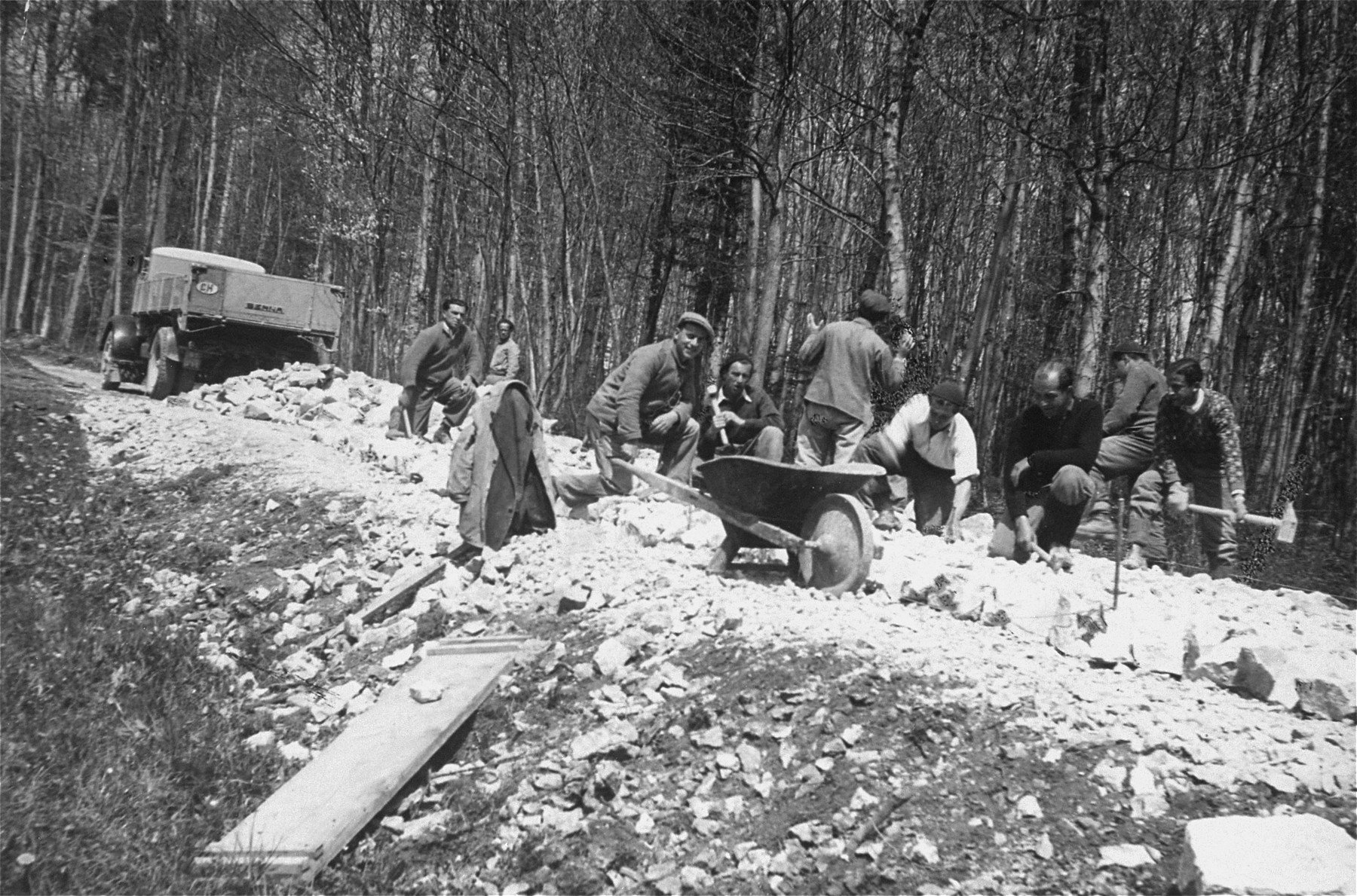 German and Austrian Jewish refugees, who have been detained in a Swiss labor camp, work in road construction.