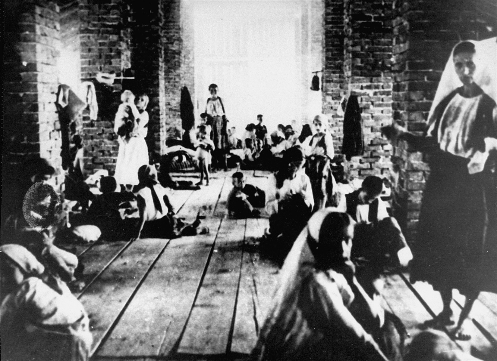 "Mothers and children imprisoned in the ""Kula"" (tower) of the Stara Gradiska concentration camp."