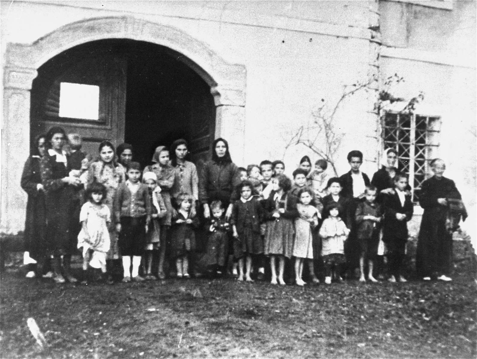 Group portrait of women and children in the Gornja Rijeka concentration camp.