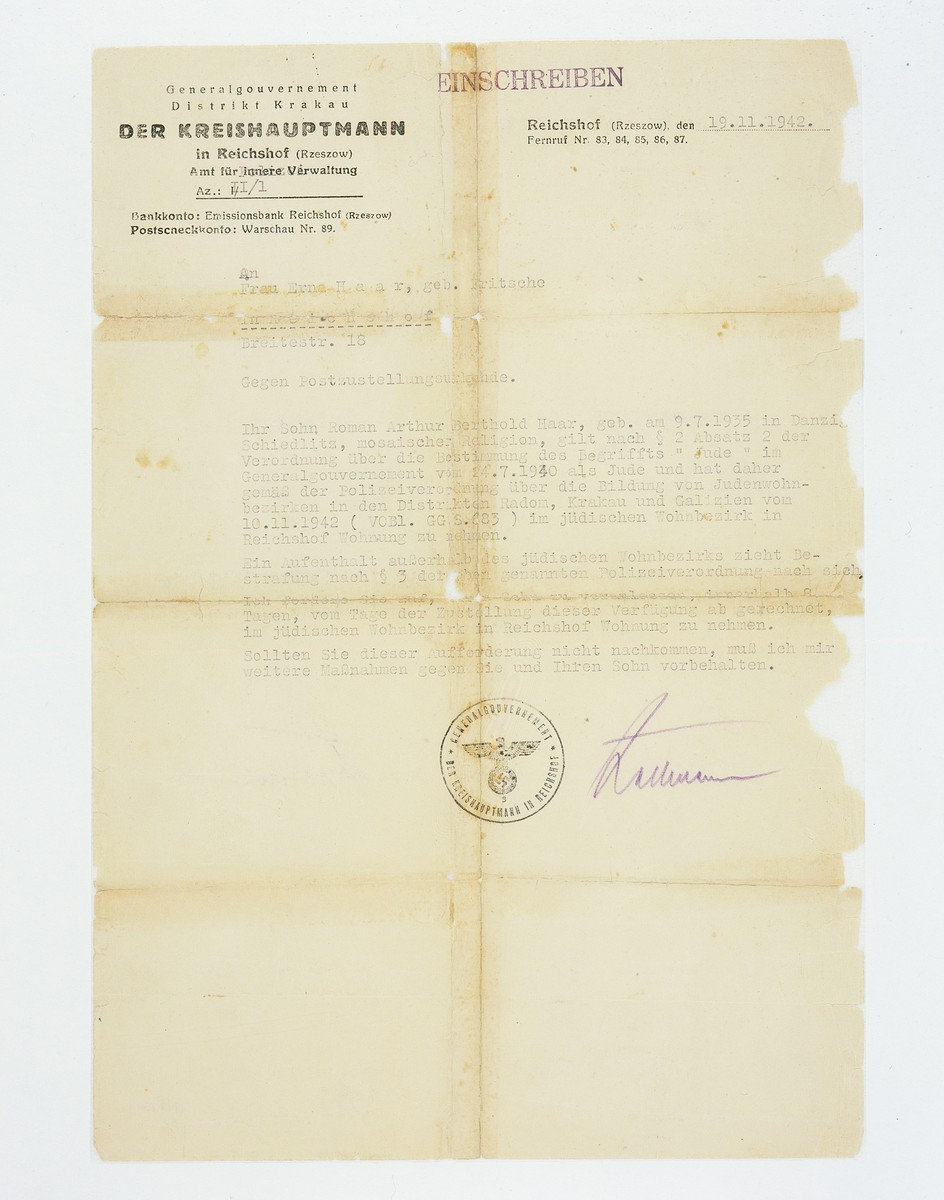 A typed letter in German that states that Roman Arthur Berthold Haar, defined by law as Jewish, must move to the Jewish quarter in Rechshof within eight days of receipt of this letter or face prosecution.