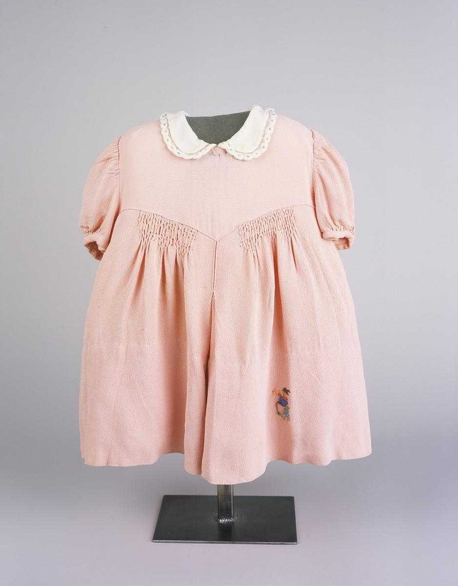 A dress worn by Lela Altarac, a Jewish child who was killed in a German bombing raid on Sarajevo during World War II.