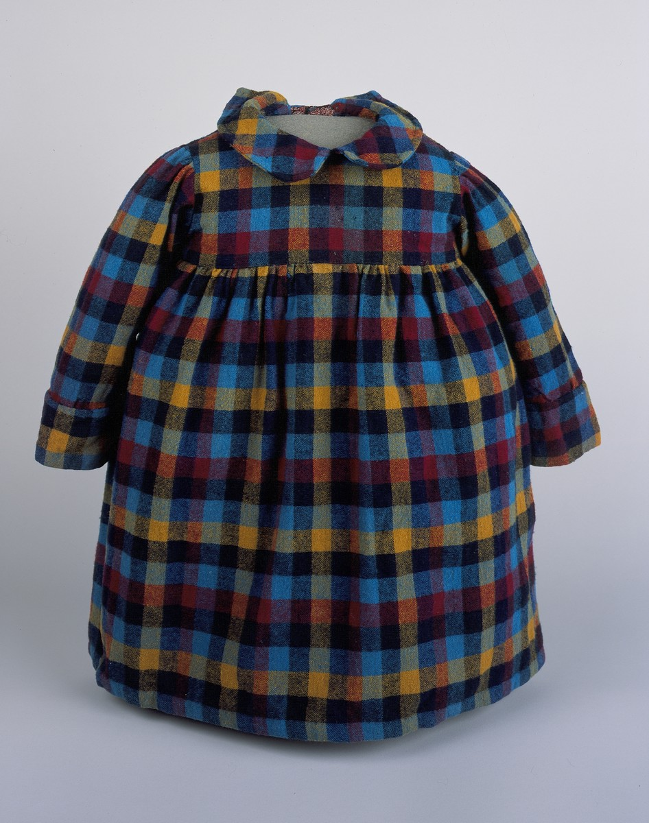 A plaid dress worn by Vera Reiss while in hiding.