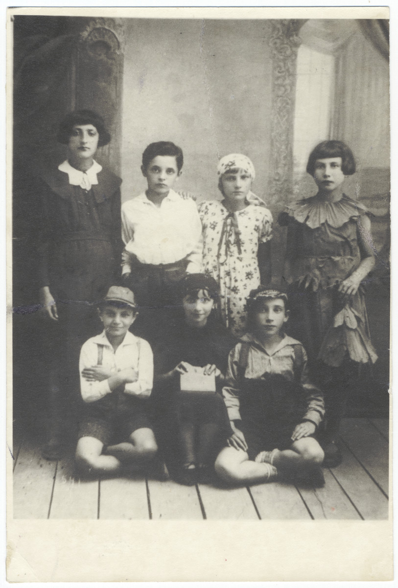 Group portrait of school girls dressed in costume for a school performance.  Among those pictured is Manya Moskowicz (second row, second from the left).