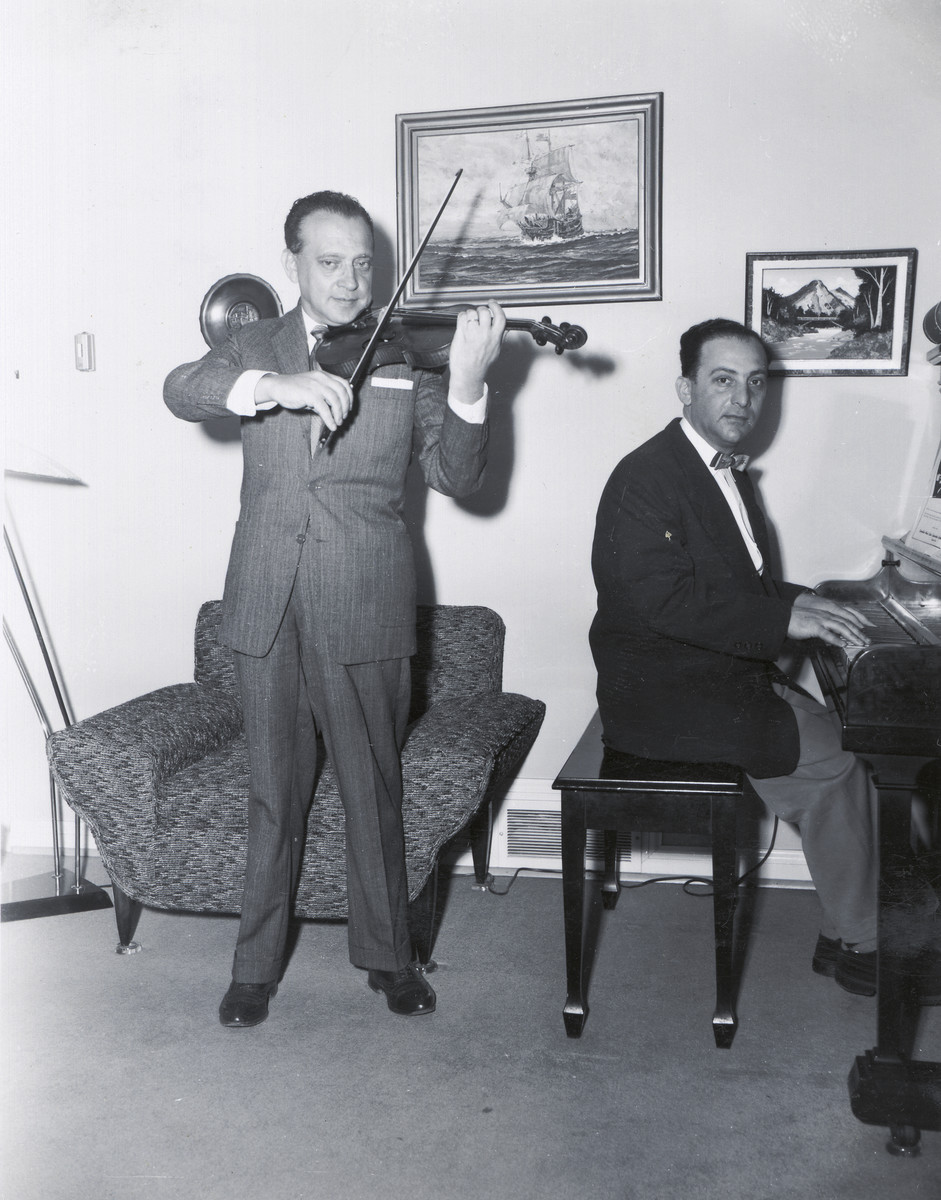Two Jewish brothers, both musicians, practice a violin-piano duet.  Pictured are Waldemar and Leo Szpilman.