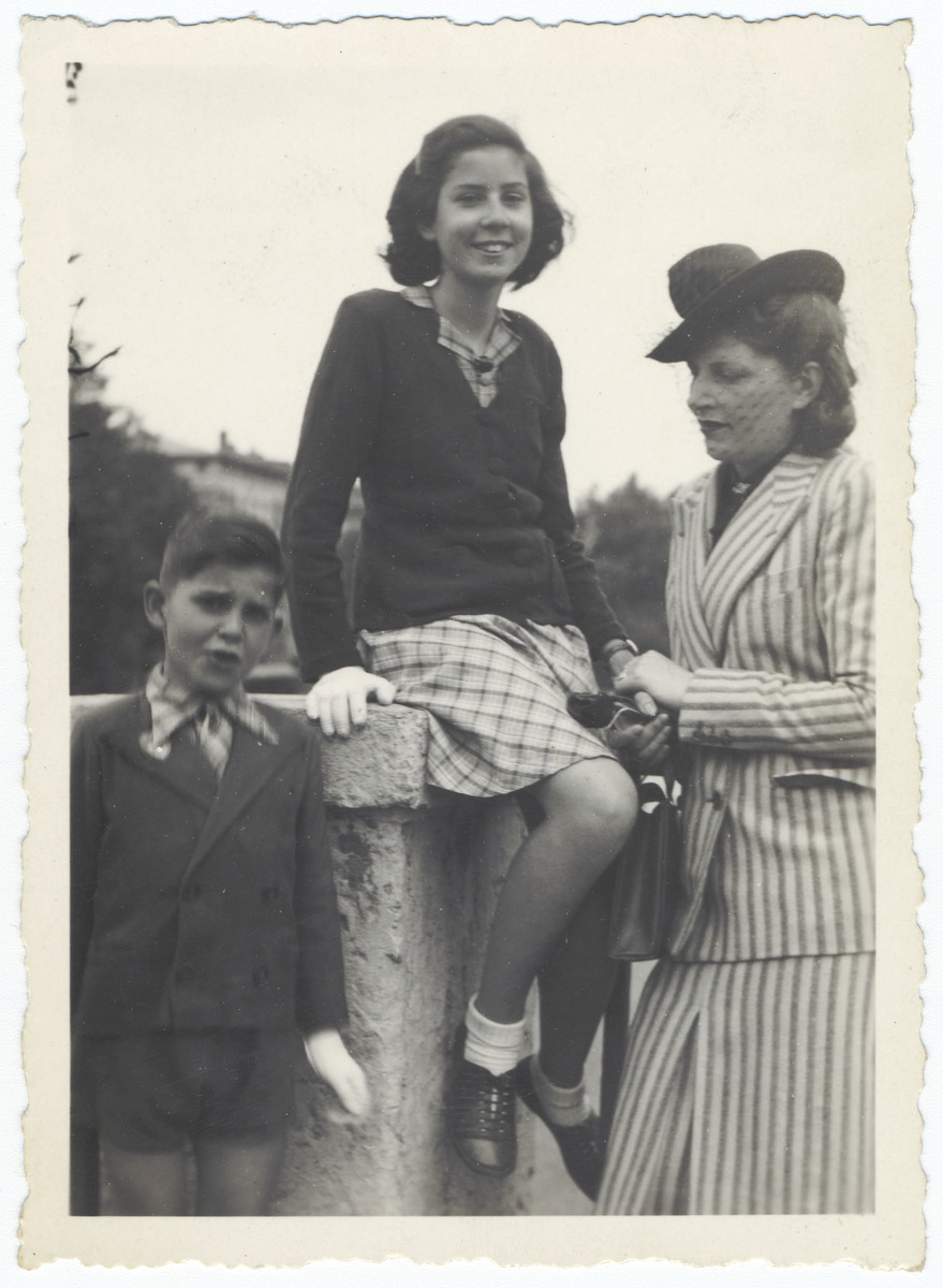 A Jewish mother and her two children pose outside where they are living in semi-hiding under their own names in Lyon.  Pictured are Josy, Renee and Louba Fainas.