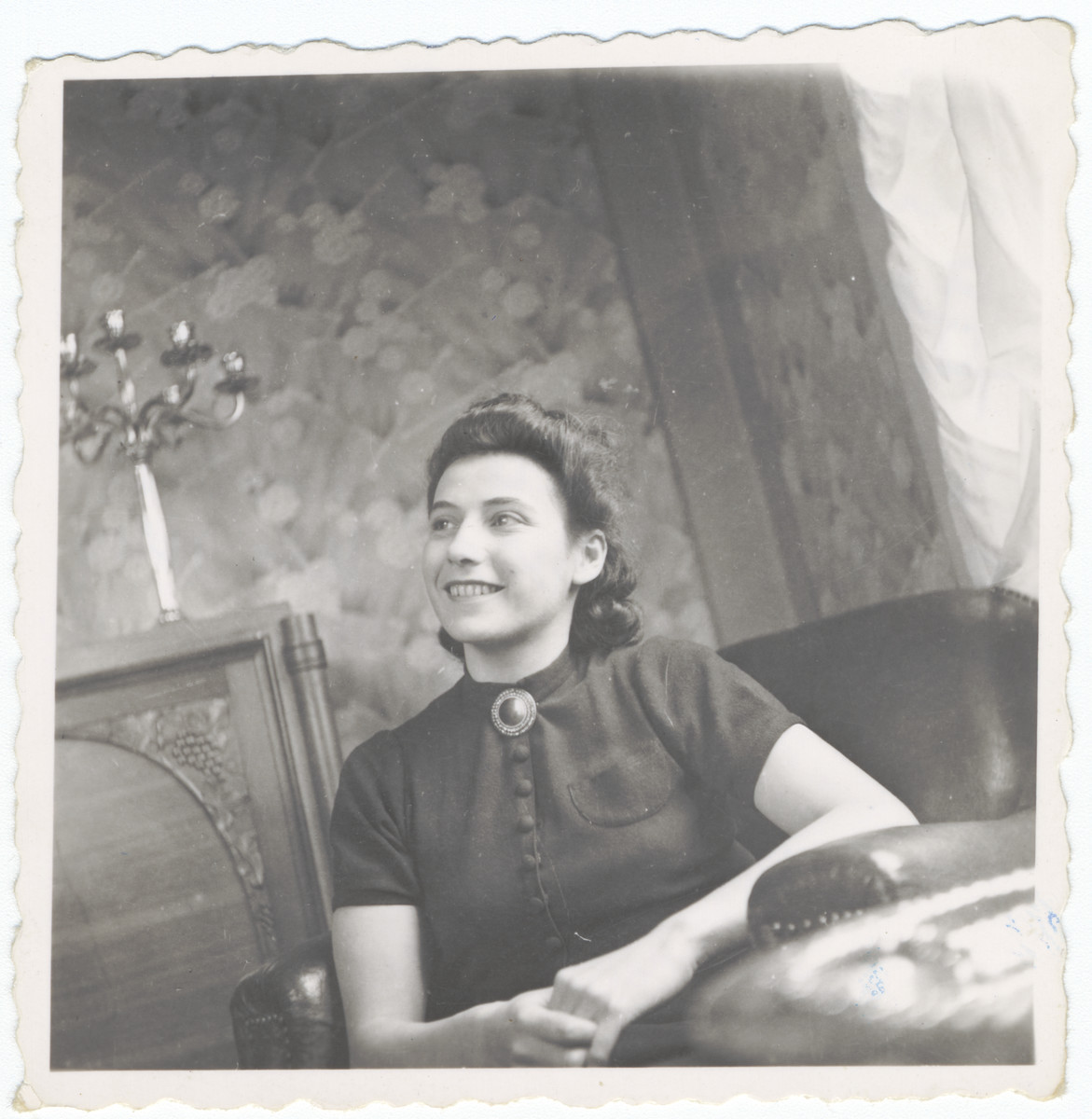 A woman sits in an apartment in Lyon.  Pictured is Liza Wolpert, the best friend of Alexander and Luba Fainas.  After she registered as a Jew, she was deported and killed.