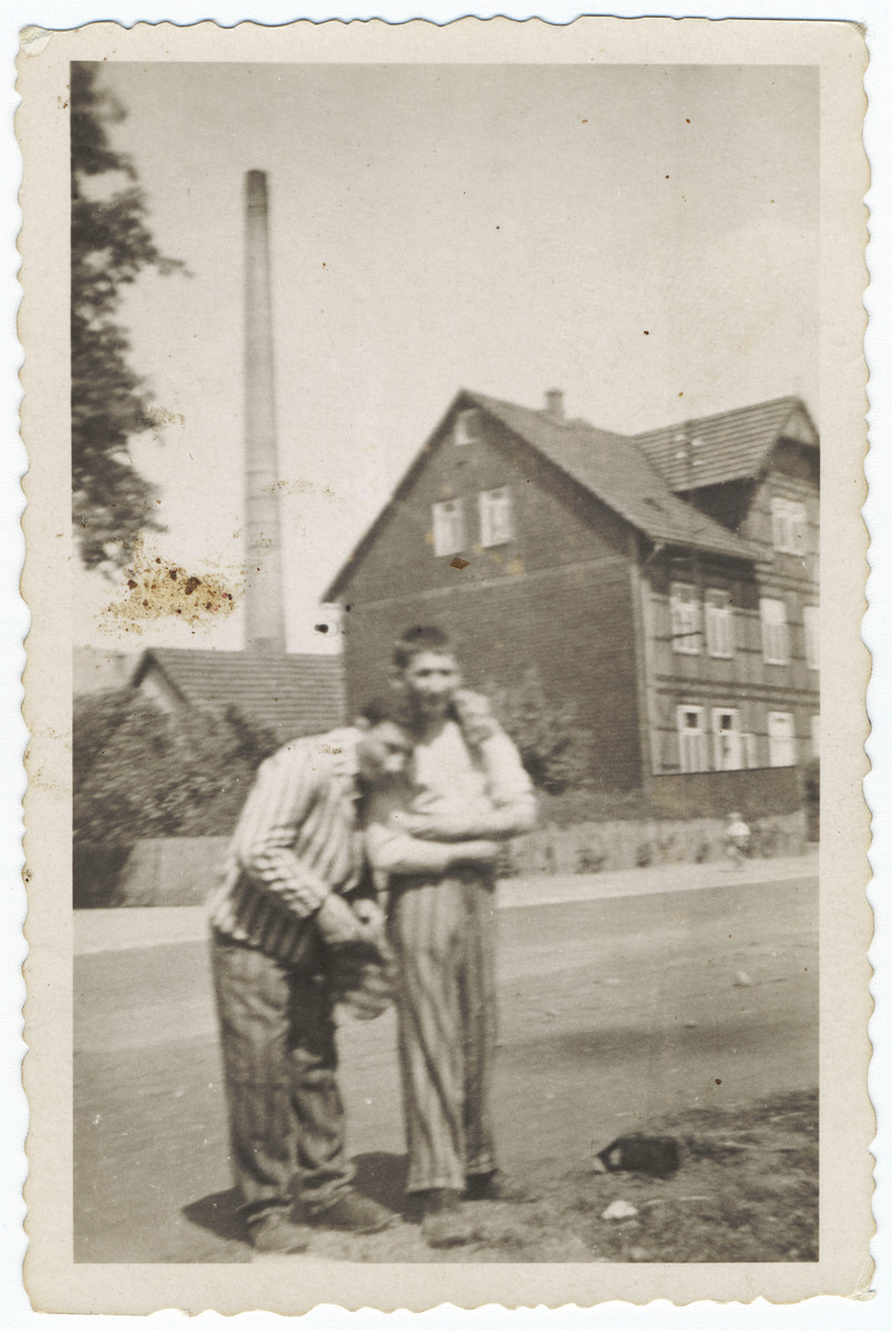 Two young survivors stand outside a building of the Buchenwald concentration camp.