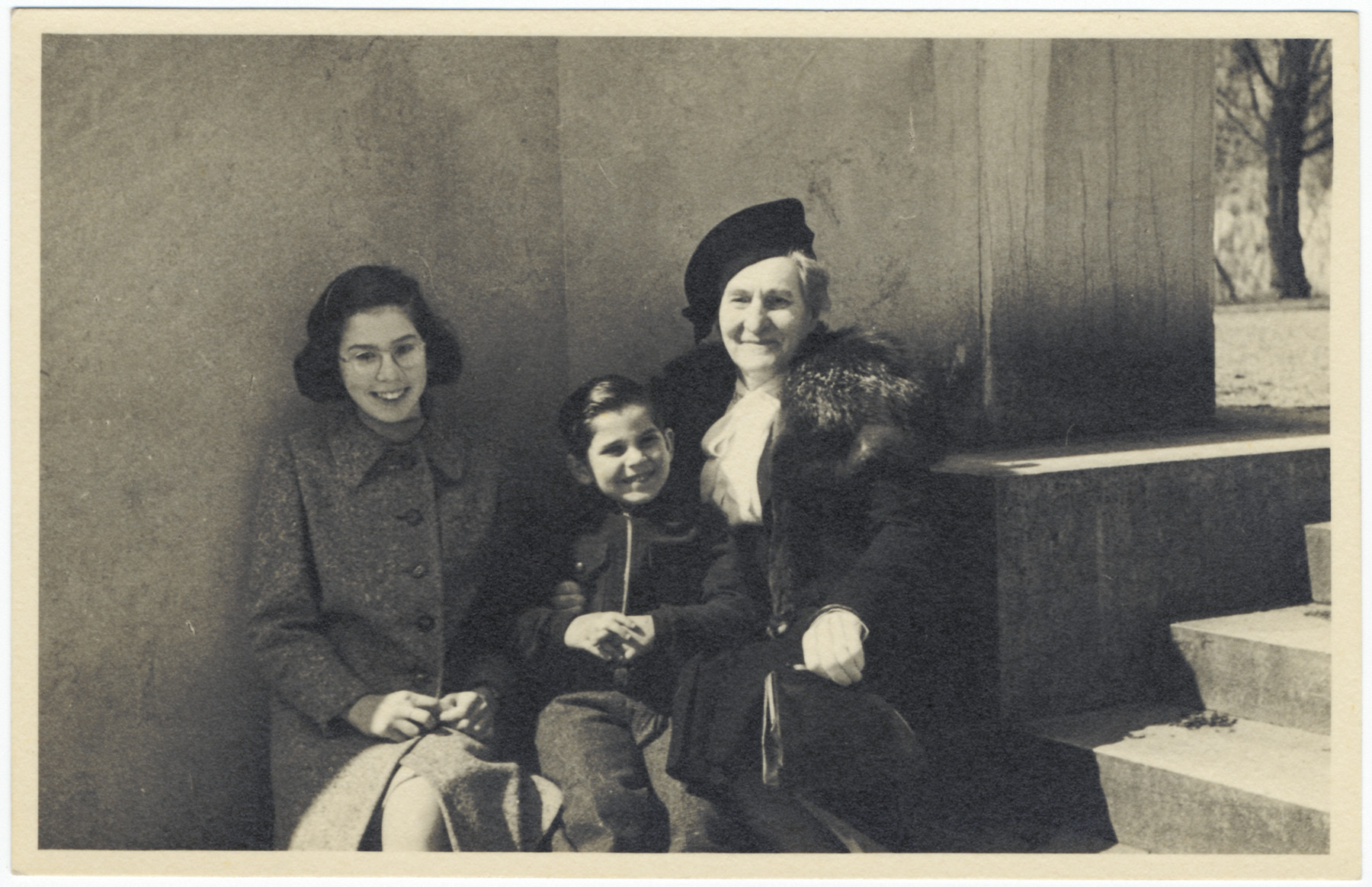 A Jewish grandmother poses with her two grandchildren in Lyons where they were living in semi-hiding under their own names.  Pictured from left to right are Renee, Yetta and Josy Fainas.